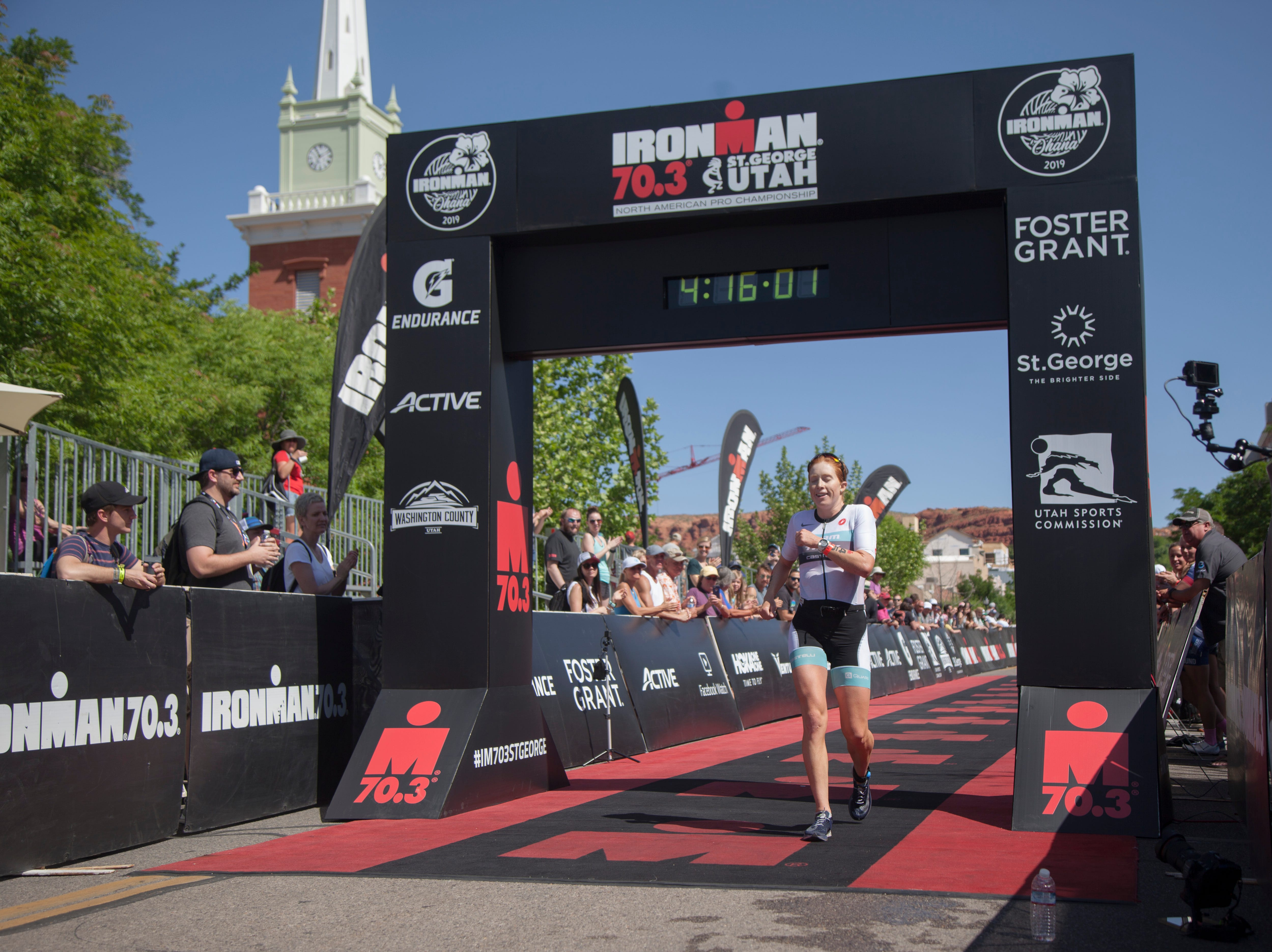 Paula Findlay crosses the finish line of the St. George Ironman Saturday, May 4, 2019.