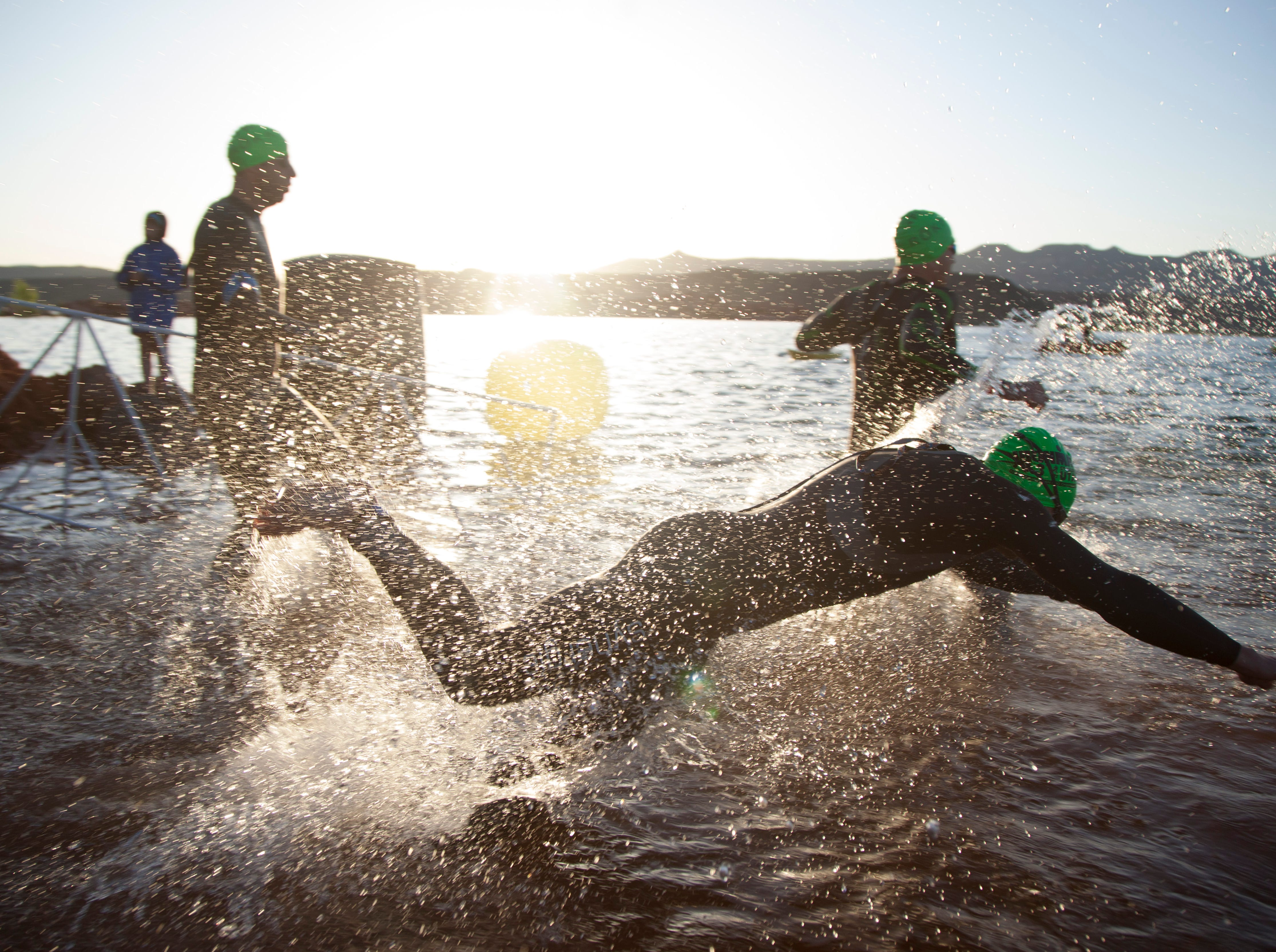 St. George Ironman contestants begin the swim portion of the race Saturday, May 4, 2019.