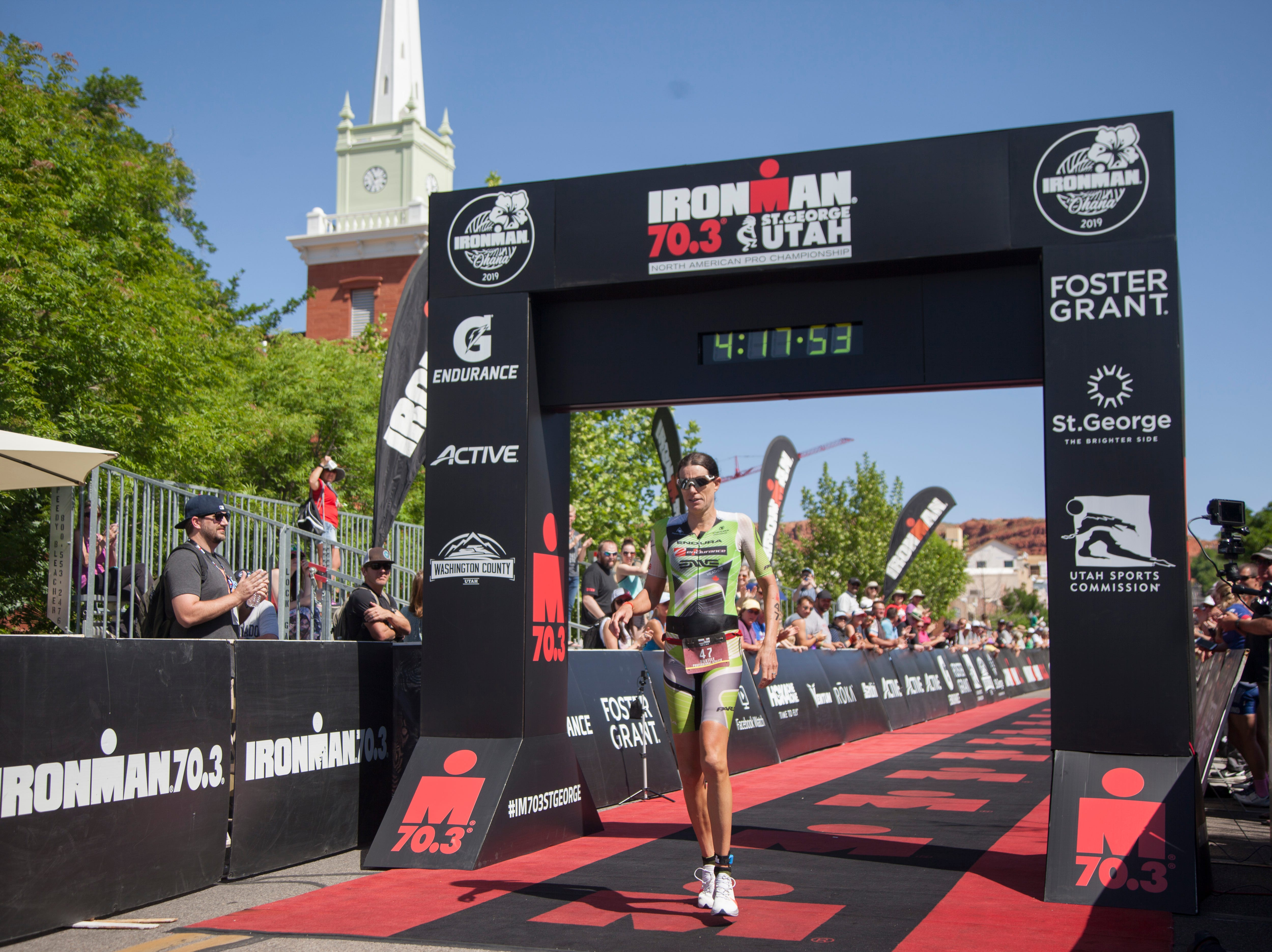 Heather Wurtele crosses the finish line of the St. George Ironman Saturday, May 4, 2019.