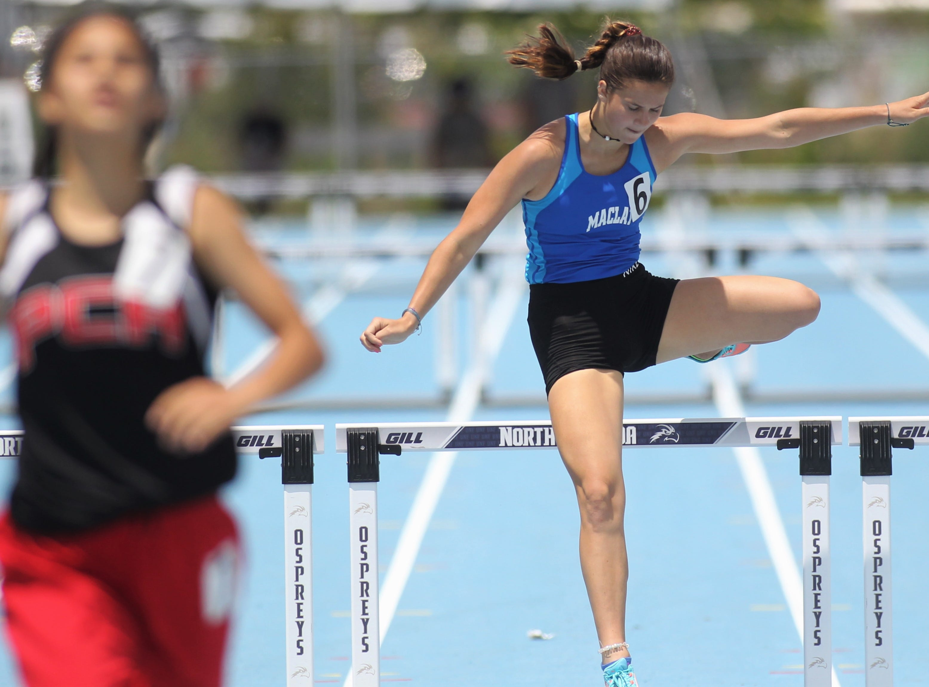 Maclay senior Kenzie Mazziotta runs the 300m hurdles at the FHSAA Track and Field State Championships at UNF's Hodges Stadium in Jacksonville on May 4, 2019.