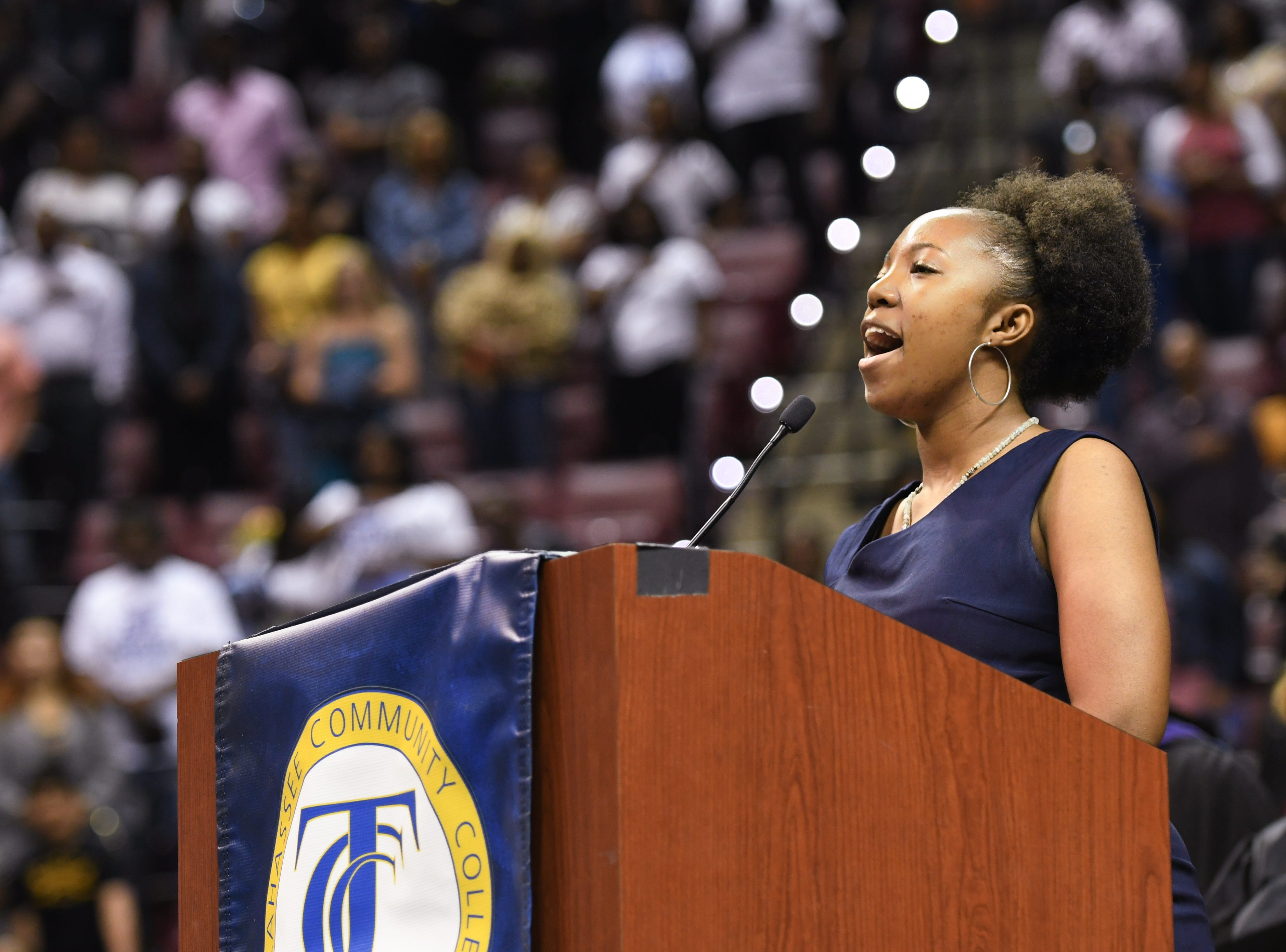 Mya Trammel sings the National Anthem before her mother, Nikki Trammel, graduates from Tallahassee Community College at Donald L. Tucker Civic Center Saturday, May 4, 2019.