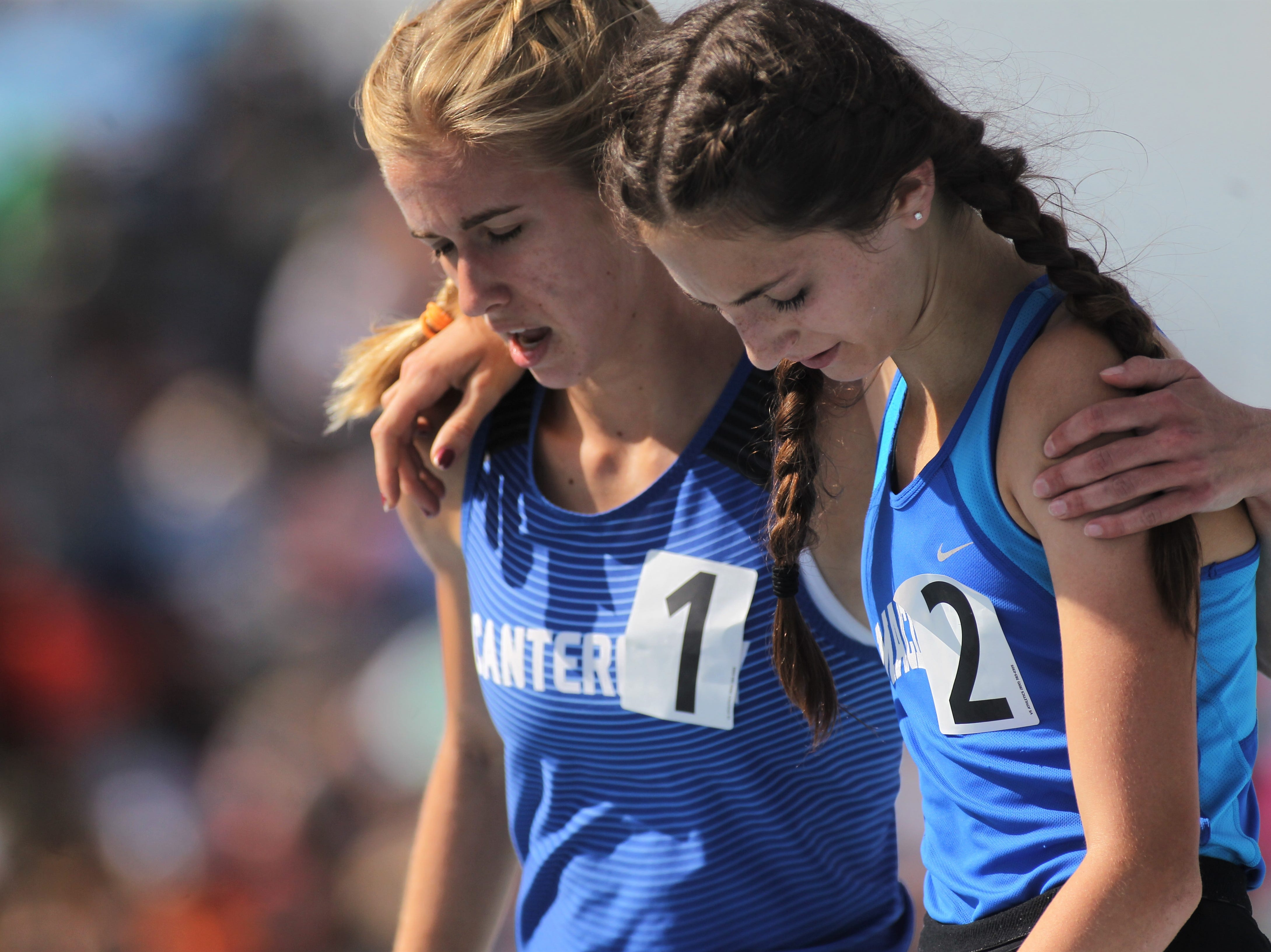 Canterbury sophomore Jessica Edwards and Maclay eighth-grader Ella Porcher share a hug after finishing 1-2 in the Class 1A 1600m run during the FHSAA Track and Field State Championships at UNF's Hodges Stadium in Jacksonville on May 4, 2019.