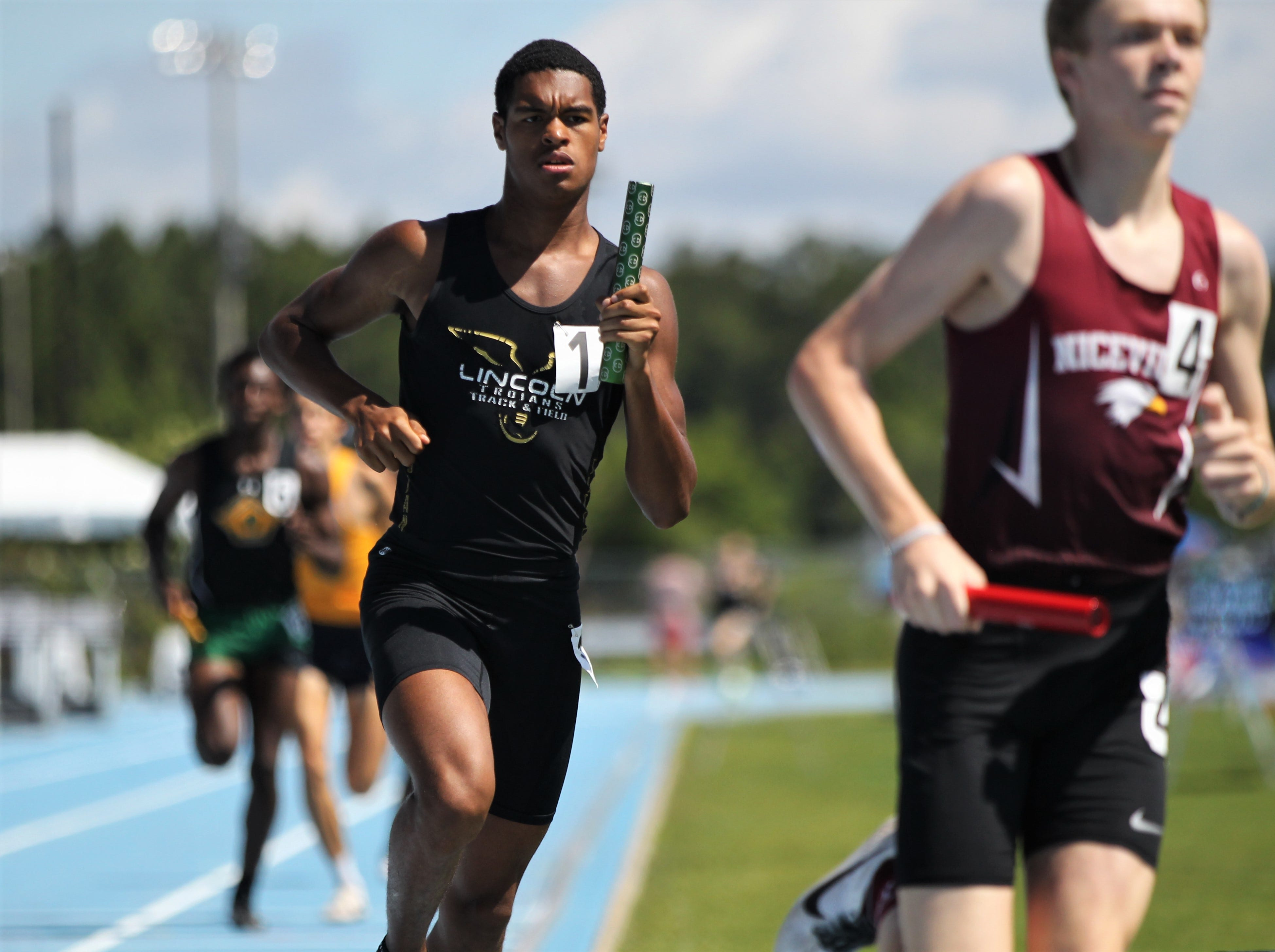 Lincoln senior Charles Hruda runs a 4x800 leg during the FHSAA Track and Field State Championships at UNF's Hodges Stadium in Jacksonville on May 4, 2019.