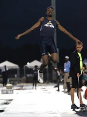 Lehigh senior Jeremiah Davis jumps to a gold medal in the Class 3A long jump during the FHSAA Track and Field State Championships at UNF's Hodges Stadium in Jacksonville on May 3.
