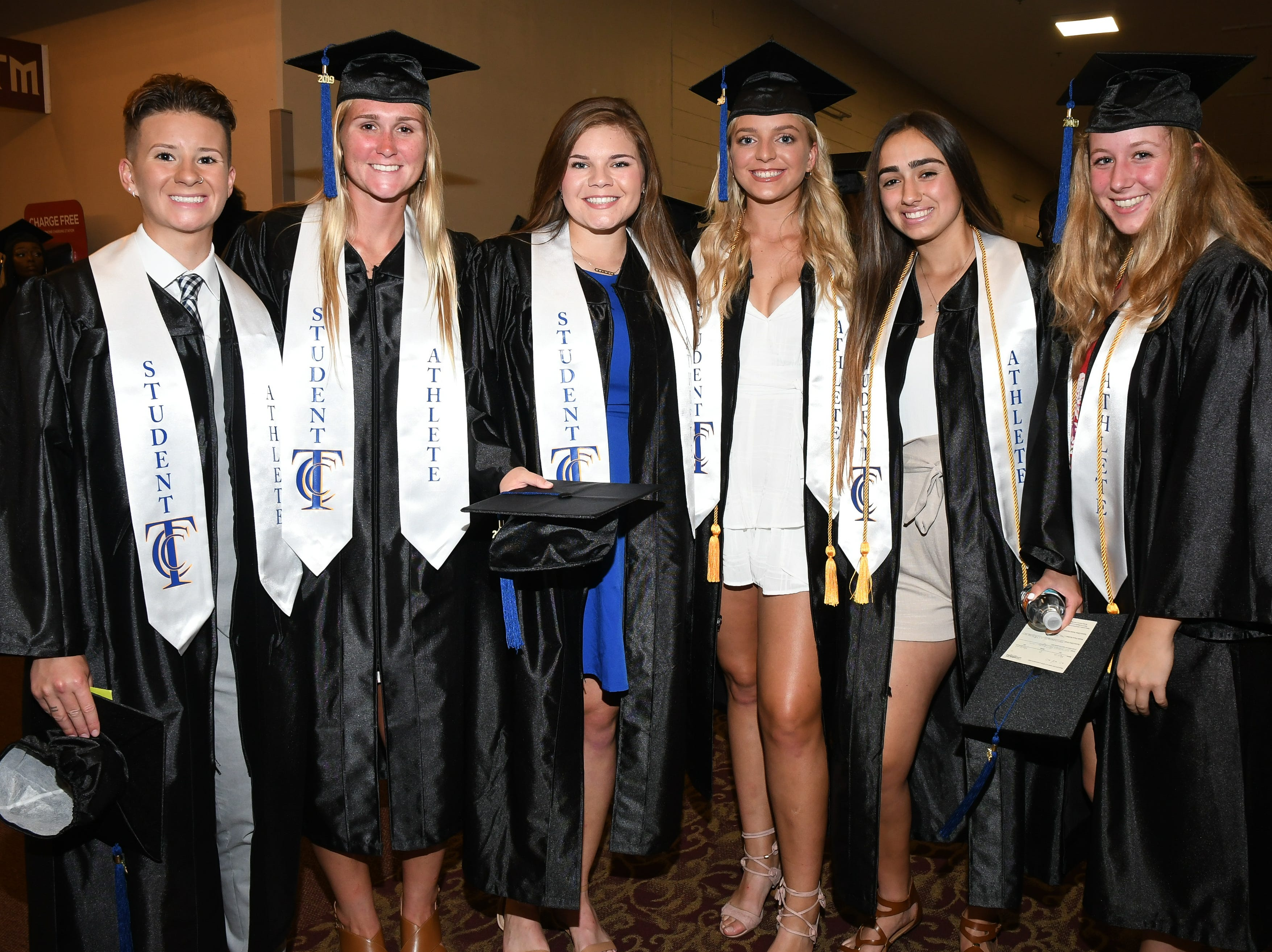Members of Tallahassee Community College's women's softball team pose for a photo as TCC hosts spring commencement at Donald L. Tucker Civic Center Saturday, May 4, 2019.