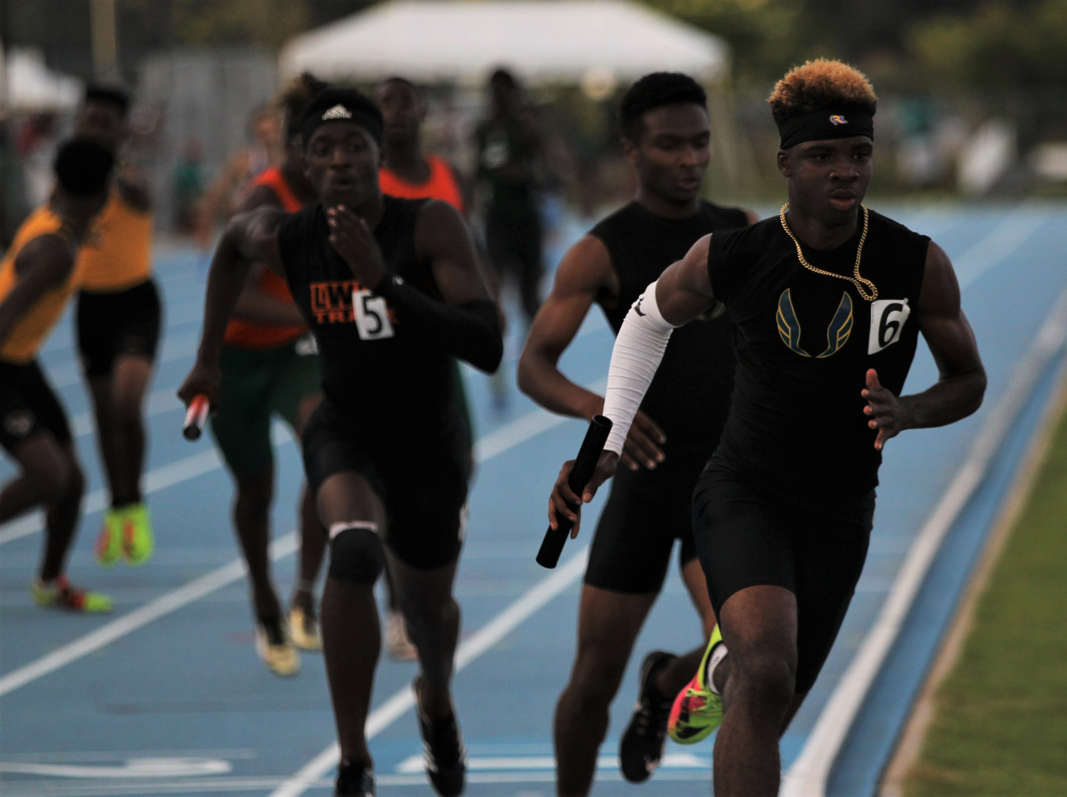 Jabari Bryant runs the anchor leg as Rickards' boys 4x400 team captured a gold medal, leading the Raiders to a Class 2A state runner-up finish at the FHSAA Track and Field State Championships on May 3 and 4, 2019.