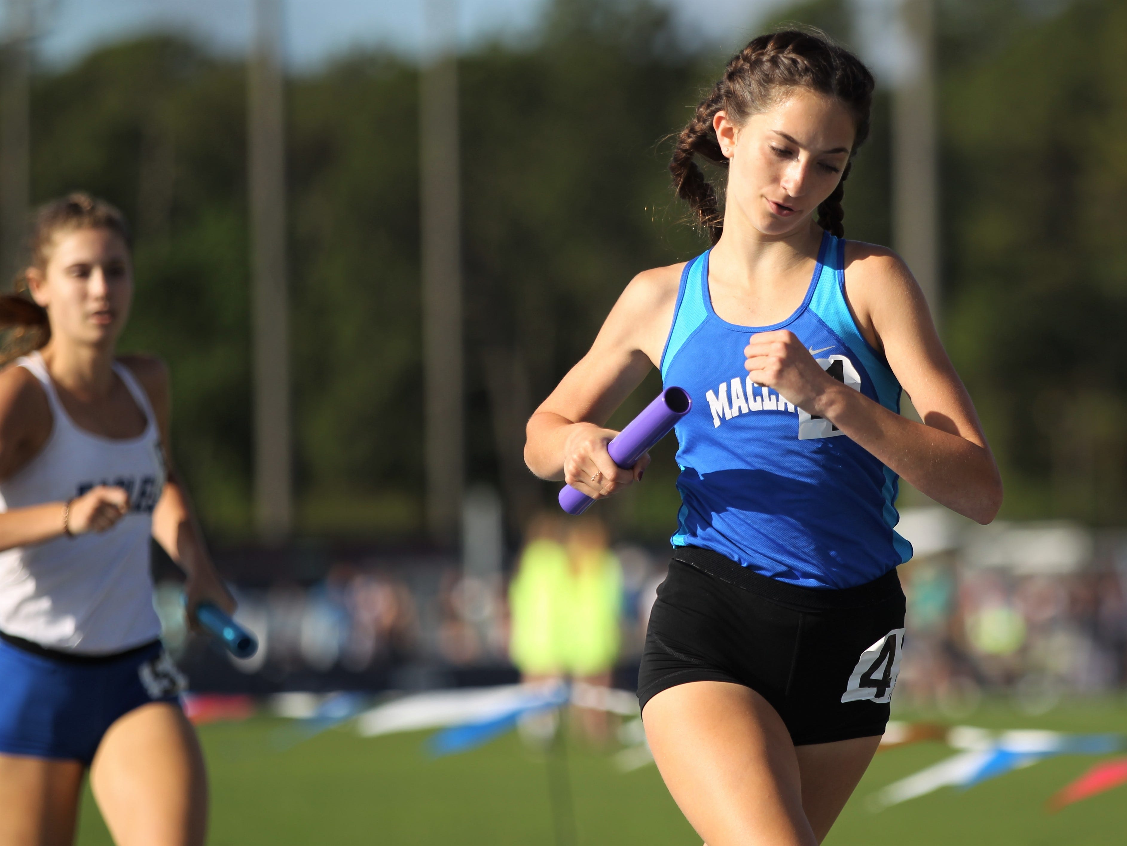 Maclay eighth-grader Ella Porcher runs a 4x800 leg during the FHSAA Track and Field State Championships at UNF's Hodges Stadium in Jacksonville on May 4, 2019.