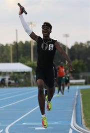 Jabari Bryant celebrates as Rickards' boys 4x400 team captured a gold medal, leading the Raiders to a Class 2A state runner-up finish at the FHSAA Track and Field State Championships on May 3 and 4, 2019.