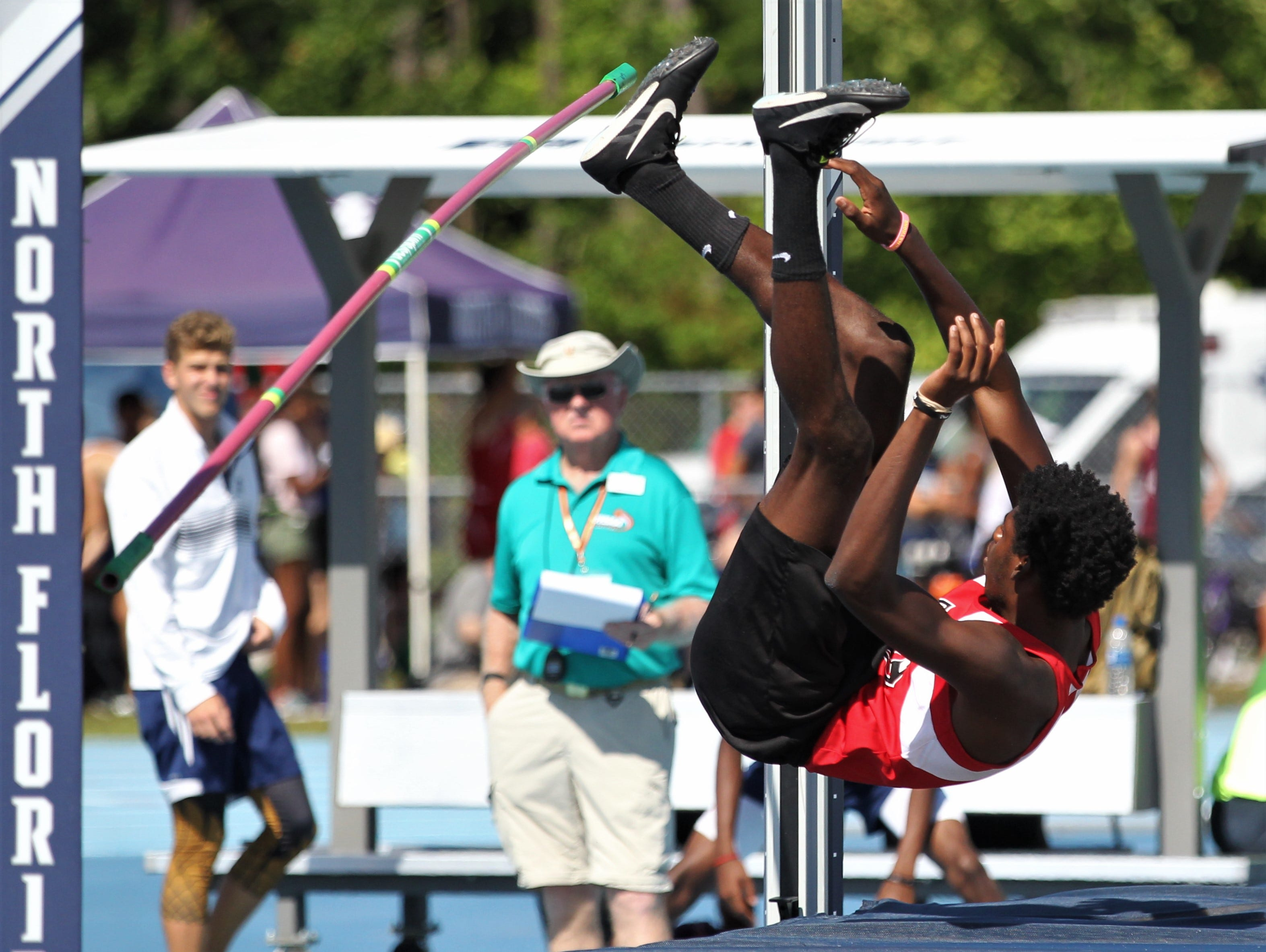 NFC senior Tredarious Langston clips the bar on high jump during the FHSAA Track and Field State Championships at UNF's Hodges Stadium in Jacksonville on May 4, 2019.