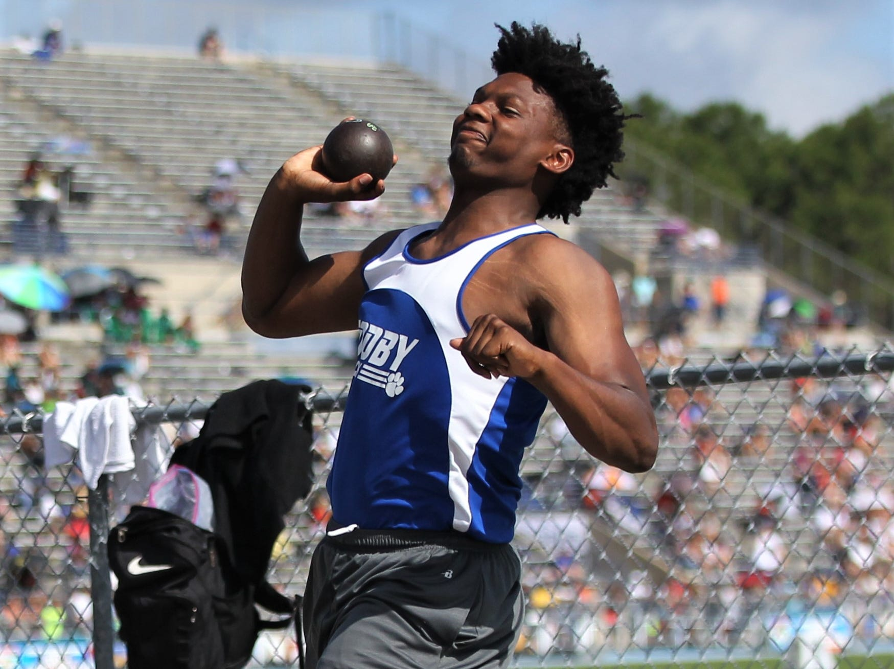 Godby senior Kamari Young throws shot put during the FHSAA Track and Field State Championships at UNF's Hodges Stadium in Jacksonville on May 4, 2019.