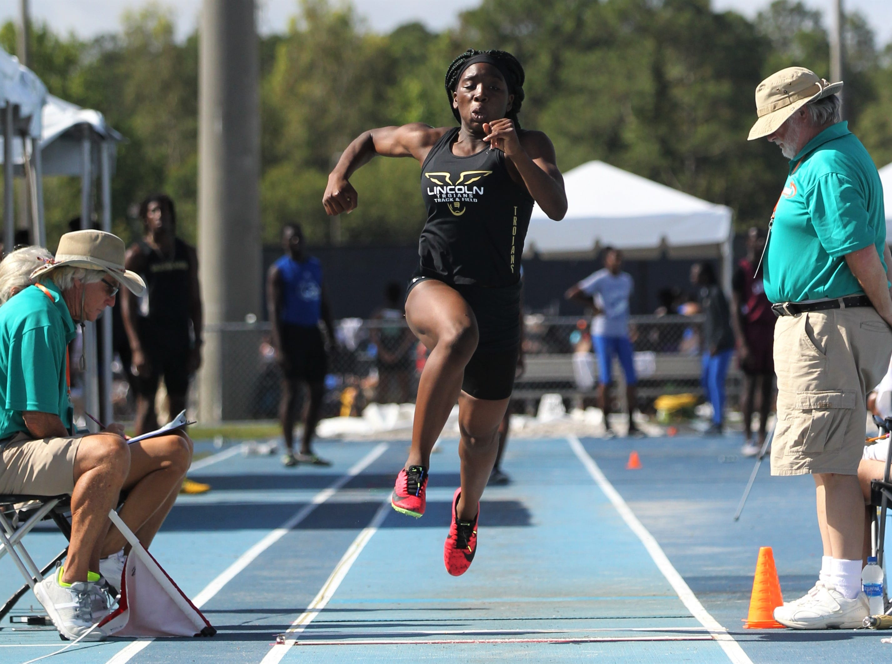 Lincoln sophomore Miahna Harden competes in triple jump during the FHSAA Track and Field State Championships at UNF's Hodges Stadium in Jacksonville on May 4, 2019.