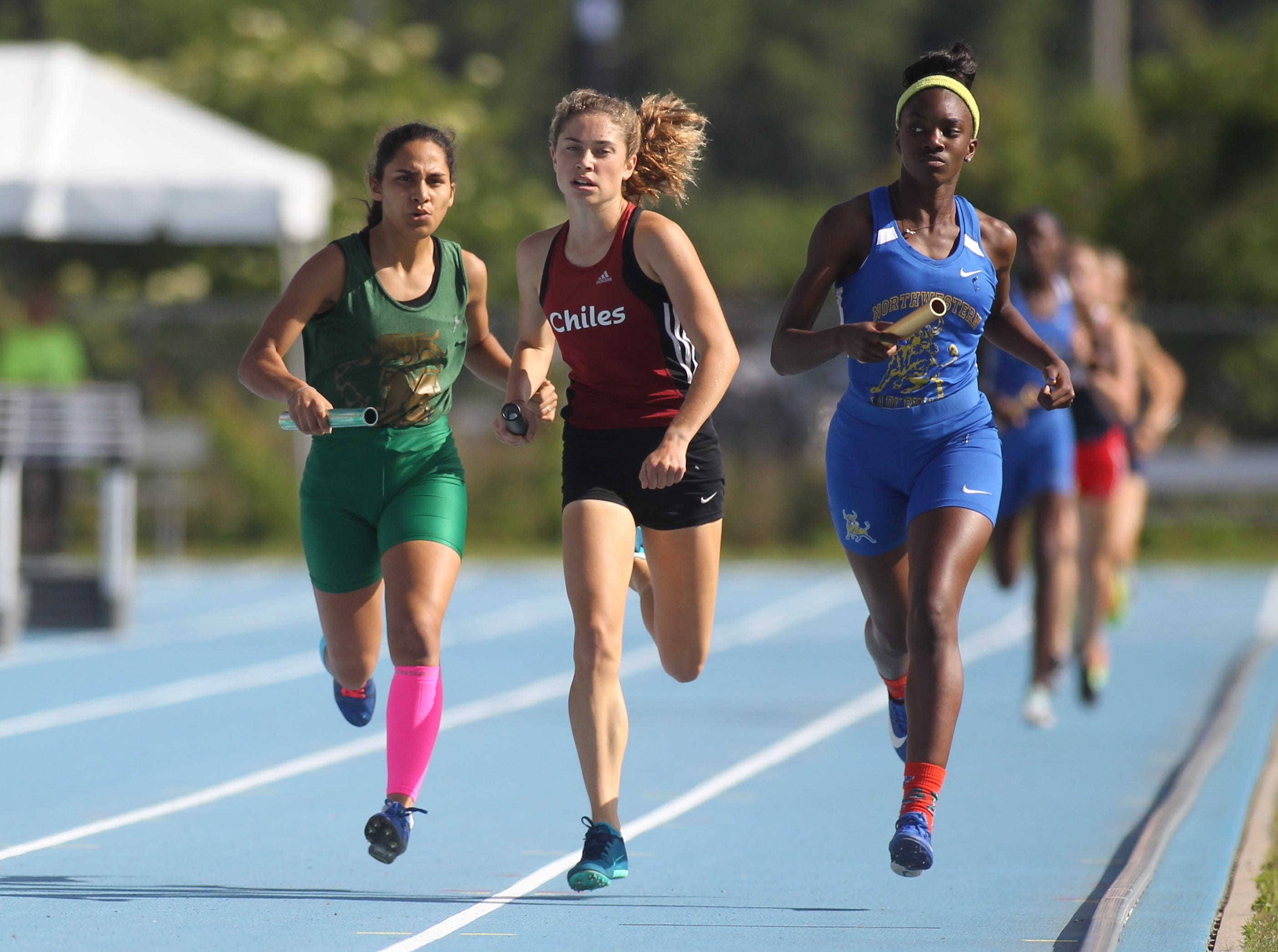 Chiles junior Alyson Churchill runs the second leg as Chiles' girls 4x800 relay captured gold in Florida's fourth-best time ever during the FHSAA Track & Field State Championships at UNF's Hodges Stadium in Jacksonville on May 4, 2019.