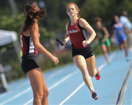 Chiles senior Emily Culley runs the third leg as Chiles' girls 4x800 relay captured gold in Florida's fourth-best time ever during the FHSAA Track & Field State Championships at UNF's Hodges Stadium in Jacksonville on May 4, 2019.