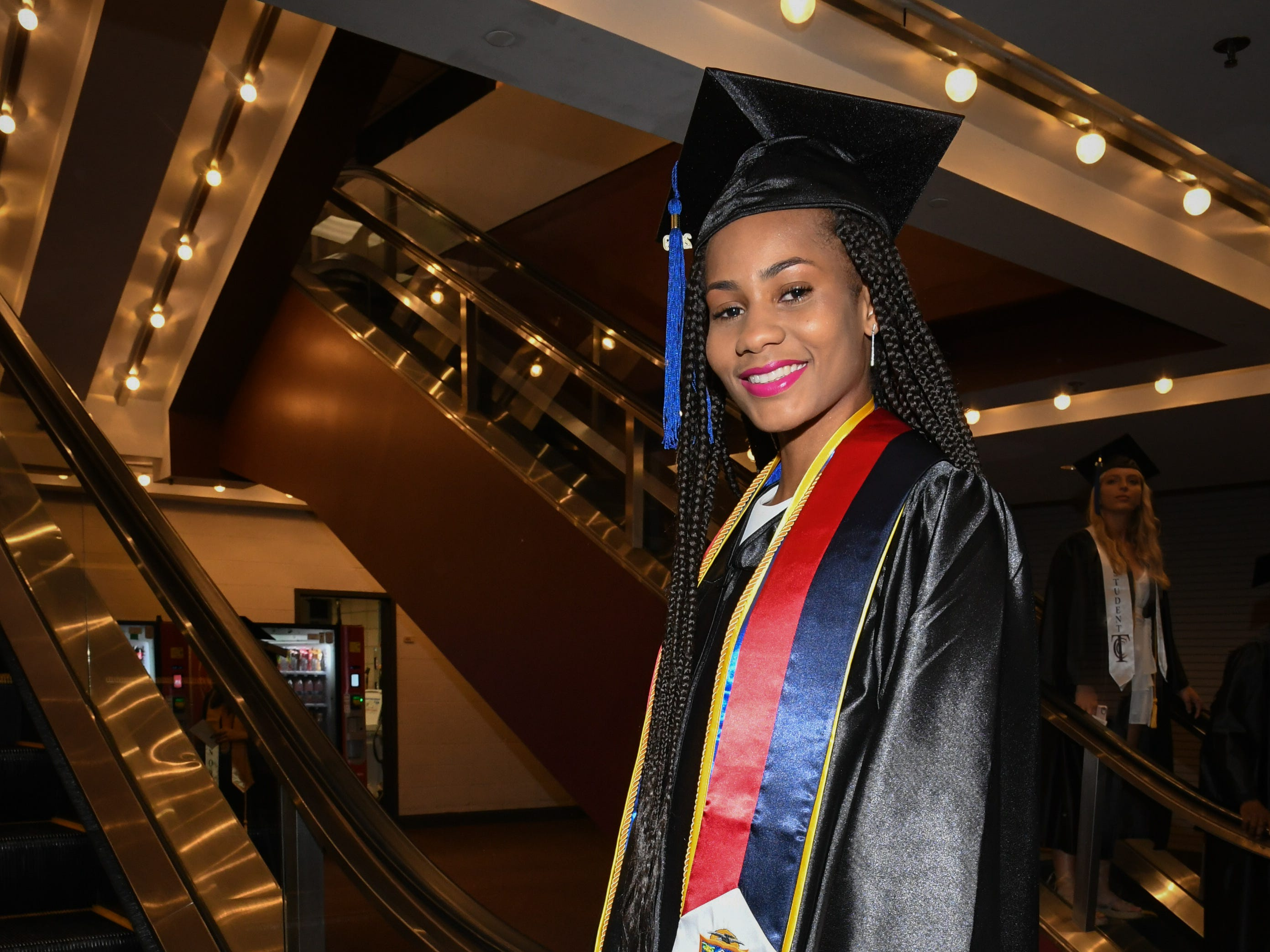 Jahmilah Lake, an international student from St. Martin, wears a stole of the island's flag after graduating from Tallahassee Community College at Donald L. Tucker Civic Center Saturday, May 4, 2019.