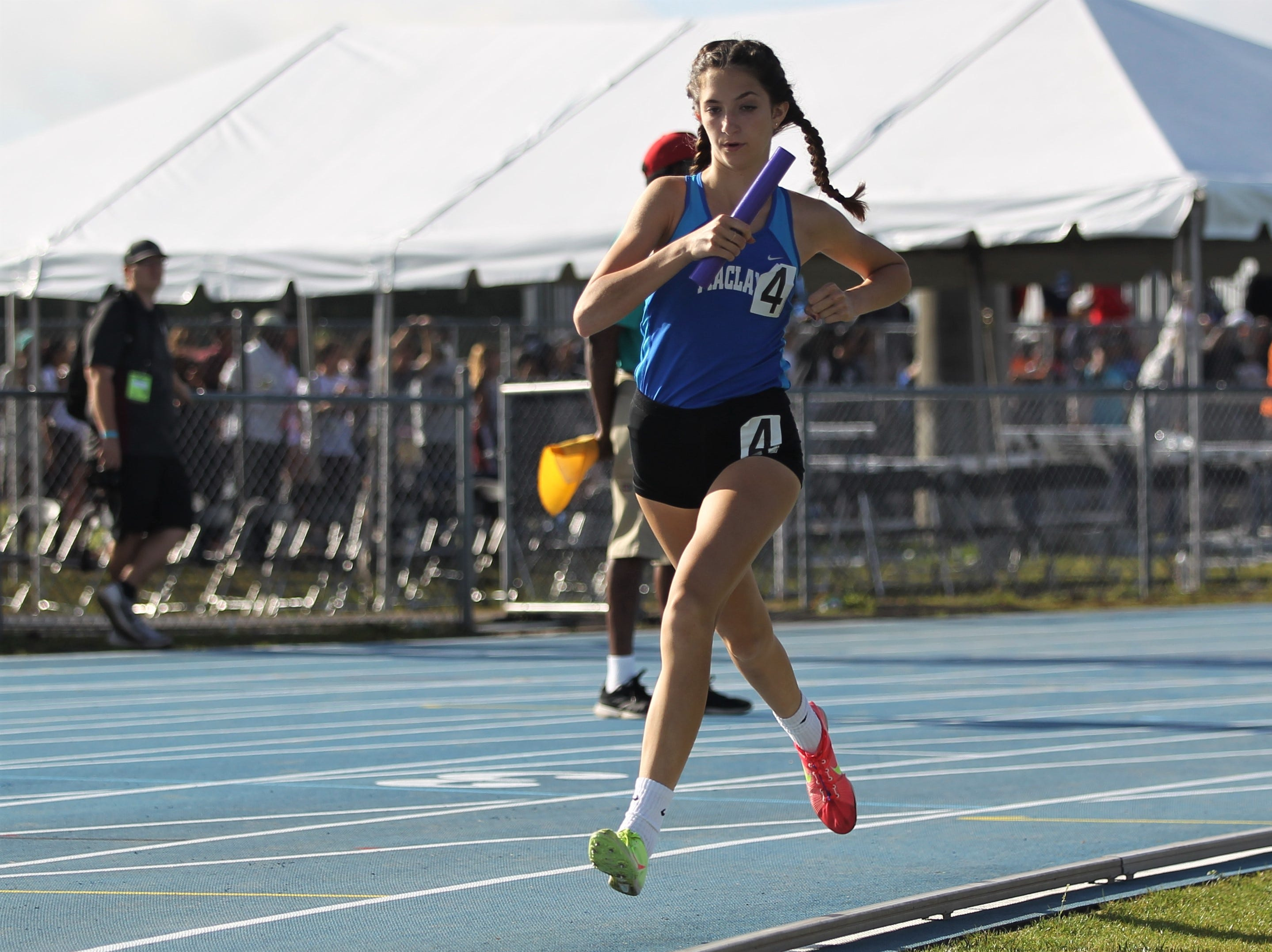 Maclay eighth-grader Ella Porcher urns a 4x800 leg during the FHSAA Track and Field State Championships at UNF's Hodges Stadium in Jacksonville on May 4, 2019.