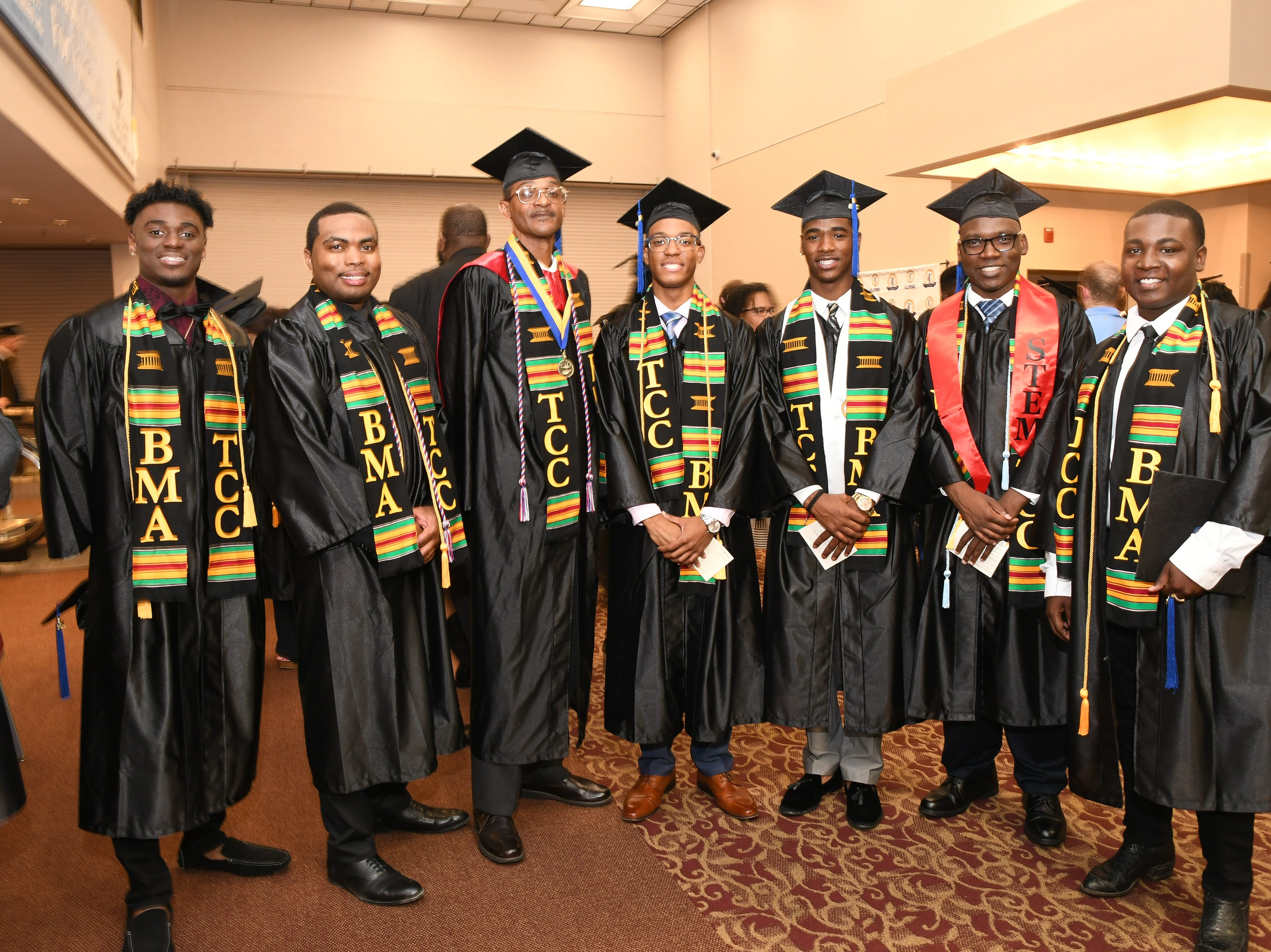 Members of Tallahassee Community College's Black Male Achievers organization pose for a photo as TCC hosts spring commencement at Donald L. Tucker Civic Center Saturday, May 4, 2019.