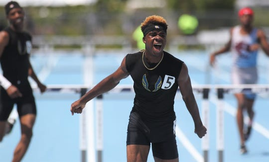 Rickards senior Jabari Bryant races to a gold medal in the 300m hurdles during the FHSAA Track and Field State Championships at UNF's Hodges Stadium in Jacksonville on May 4, 2019.