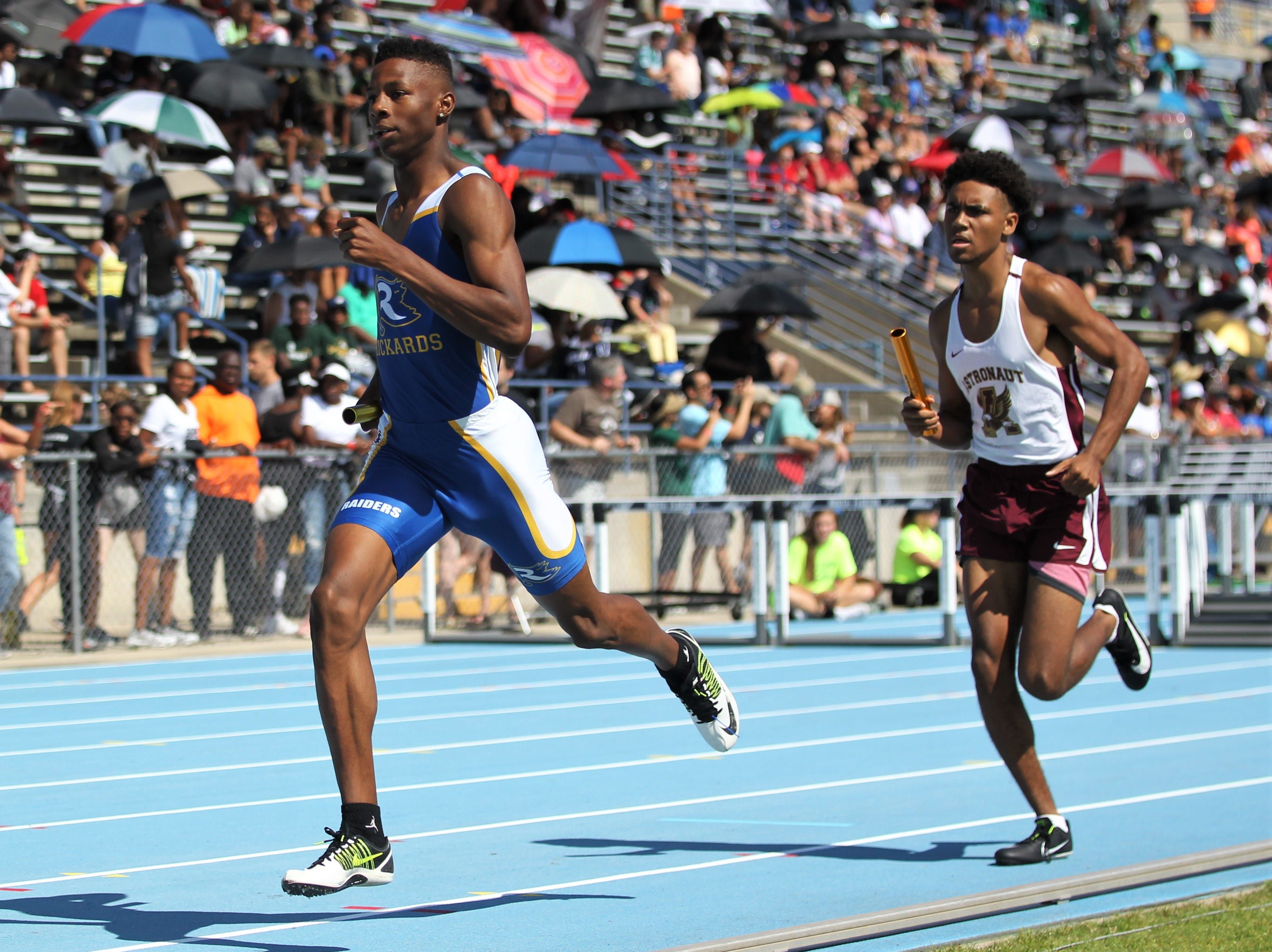 Rickards senior Chris Robinson runs a 4x800 leg during the FHSAA Track and Field State Championships at UNF's Hodges Stadium in Jacksonville on May 4, 2019.