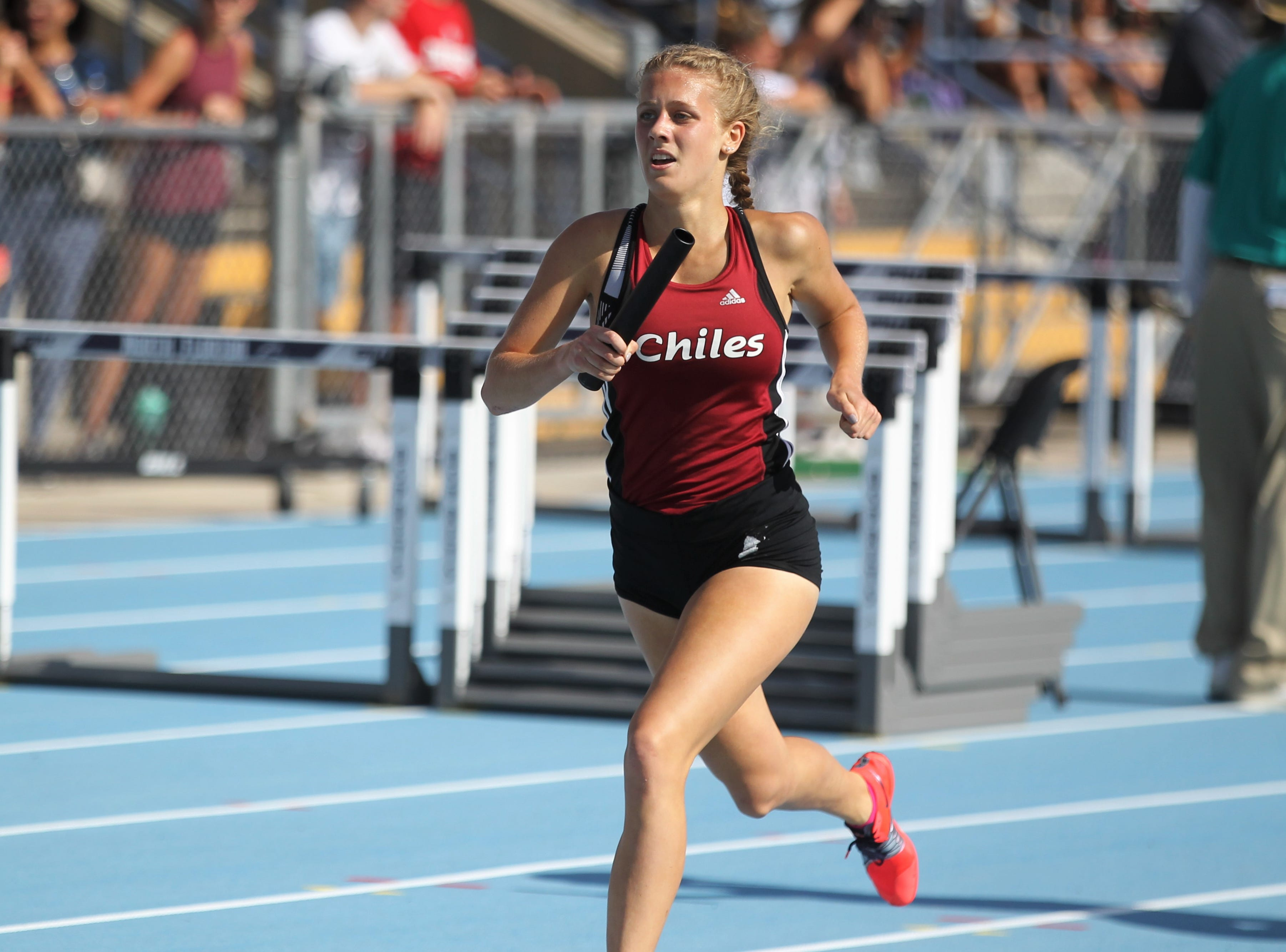 Chiles junior Caitlin Wilkey runs the lead-off leg as Chiles' girls 4x800 relay captured gold in Florida's fourth-best time ever during the FHSAA Track & Field State Championships at UNF's Hodges Stadium in Jacksonville on May 4, 2019.