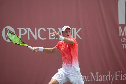 Dmitry Popko hits a forehand during his win at the Mardy Fish Children's Foundation Tennis Championships final Sunday at The Boulevard.