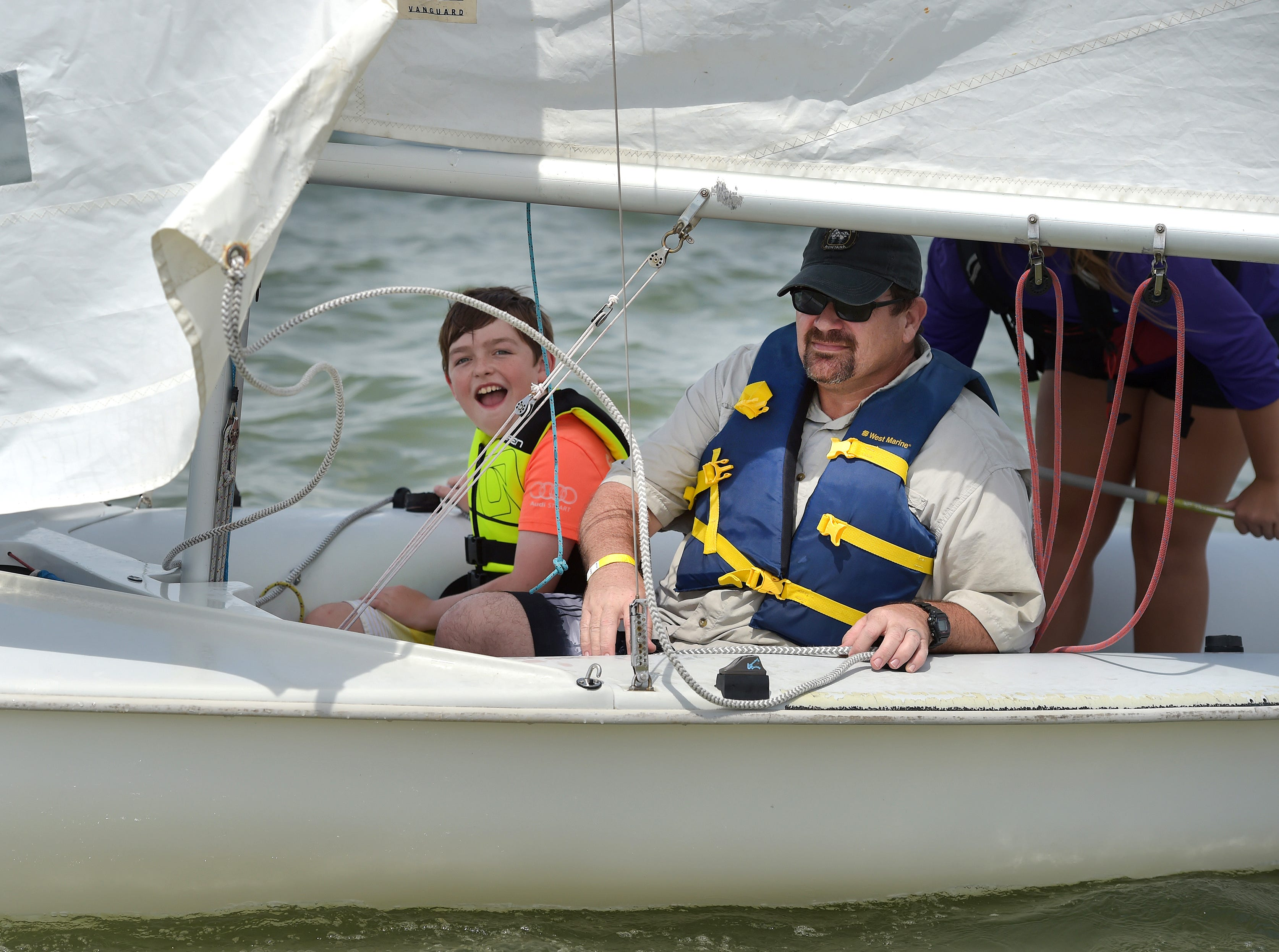 "Xavier Appleton, 10 (left), and his father Bill Appleton, of Jensen Beach, enjoy the experience of sailing on a 420 class boat together during 2019 Waterfest on Sunday, May 5, 2019, at Jaycee Park in Fort Pierce. ""It's fun because we get to pull in the line so it turns, feeling it [water], touching buoys,"" Xavier said about the sailing experience. The event, co-sponsored by the Fort Pierce Yacht Club, City of Fort Pierce, Treasure Coast Youth Sailing Foundation and the Fort Pierce Jazz and Blues Society, introduces the experience of being on the water with sailing, kayaking, canoeing, paddle boarding, and other water activities in the Indian River Lagoon for free. ""Today is about giving back to the community, showing all the residents in St. Lucie County [and beyond] just what our natural resources and what we have to offer,"" said Charlie Hayek, secretary of TCYSF in Fort Pierce."