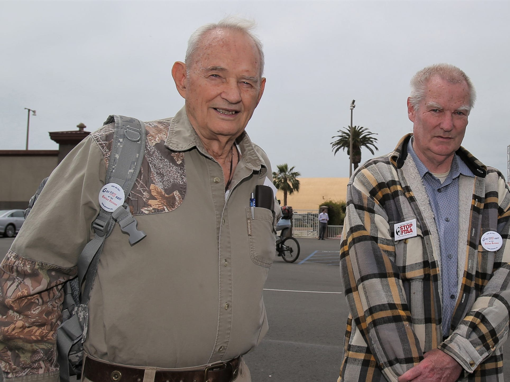 William Peck, left, and Robert Huber were among the supporters and shoppers at the Crossroads of the West Gun Show that was held Saturday at the Ventura County Fairgrounds. Peck and Huber hope that the show doesn't go away.
