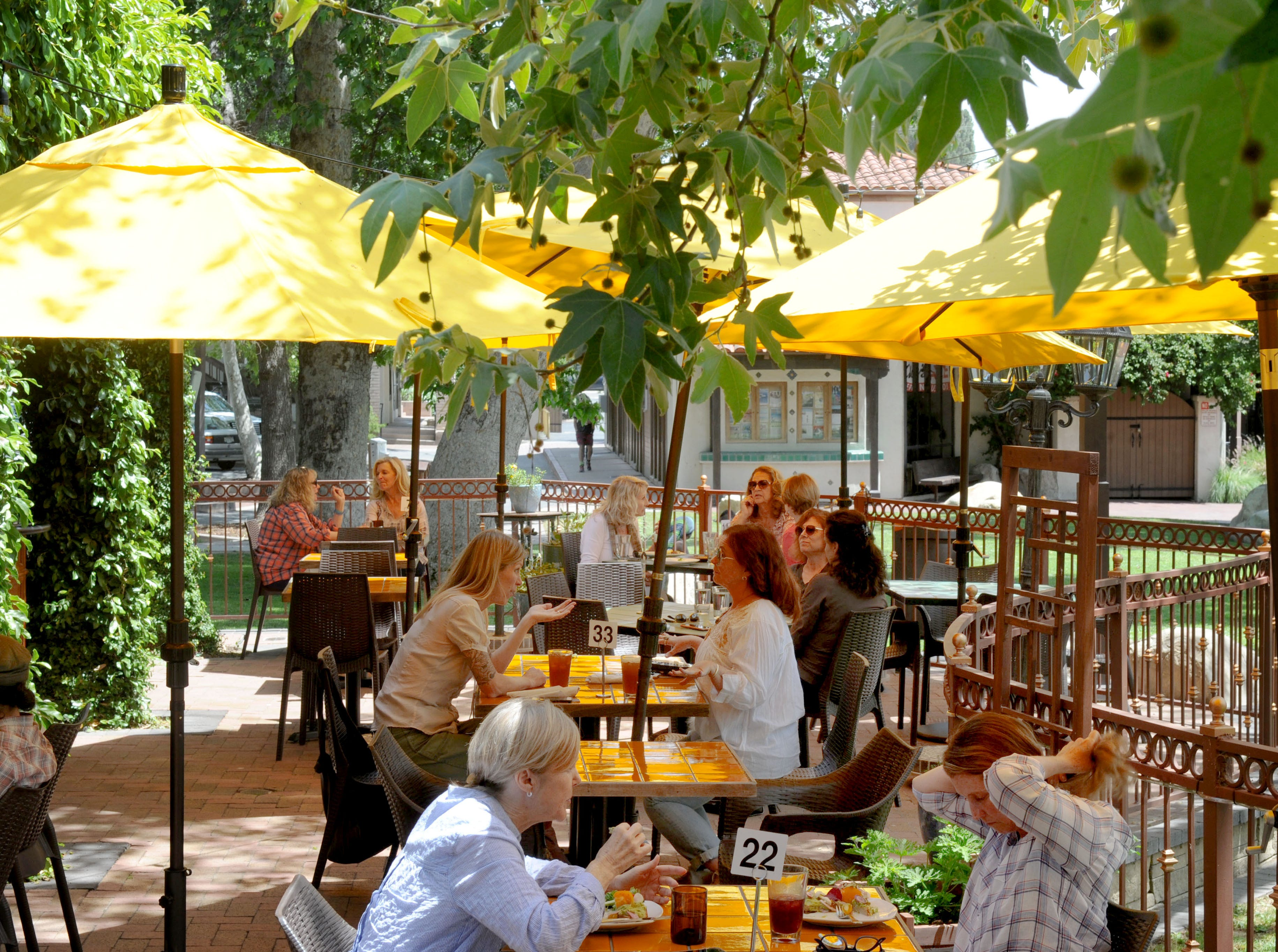 A group of people enjoy lunch at the outdoor patio at Sage Mindful Meals and Elixirs in Ojai.