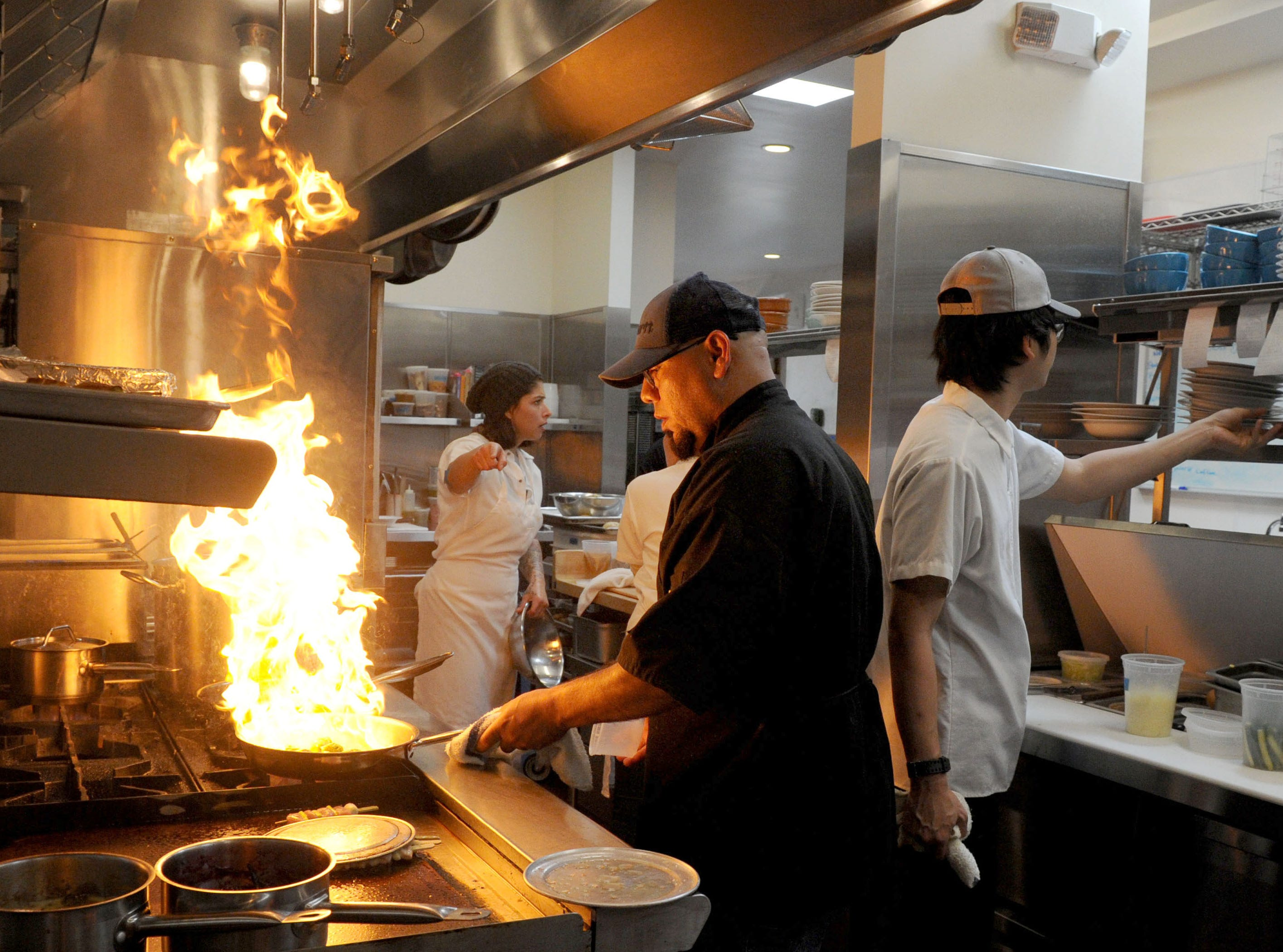 Manolo Barbosa, sous-chef at Sage Mindful Meals and Elixirs in Ojai cooks a dish.