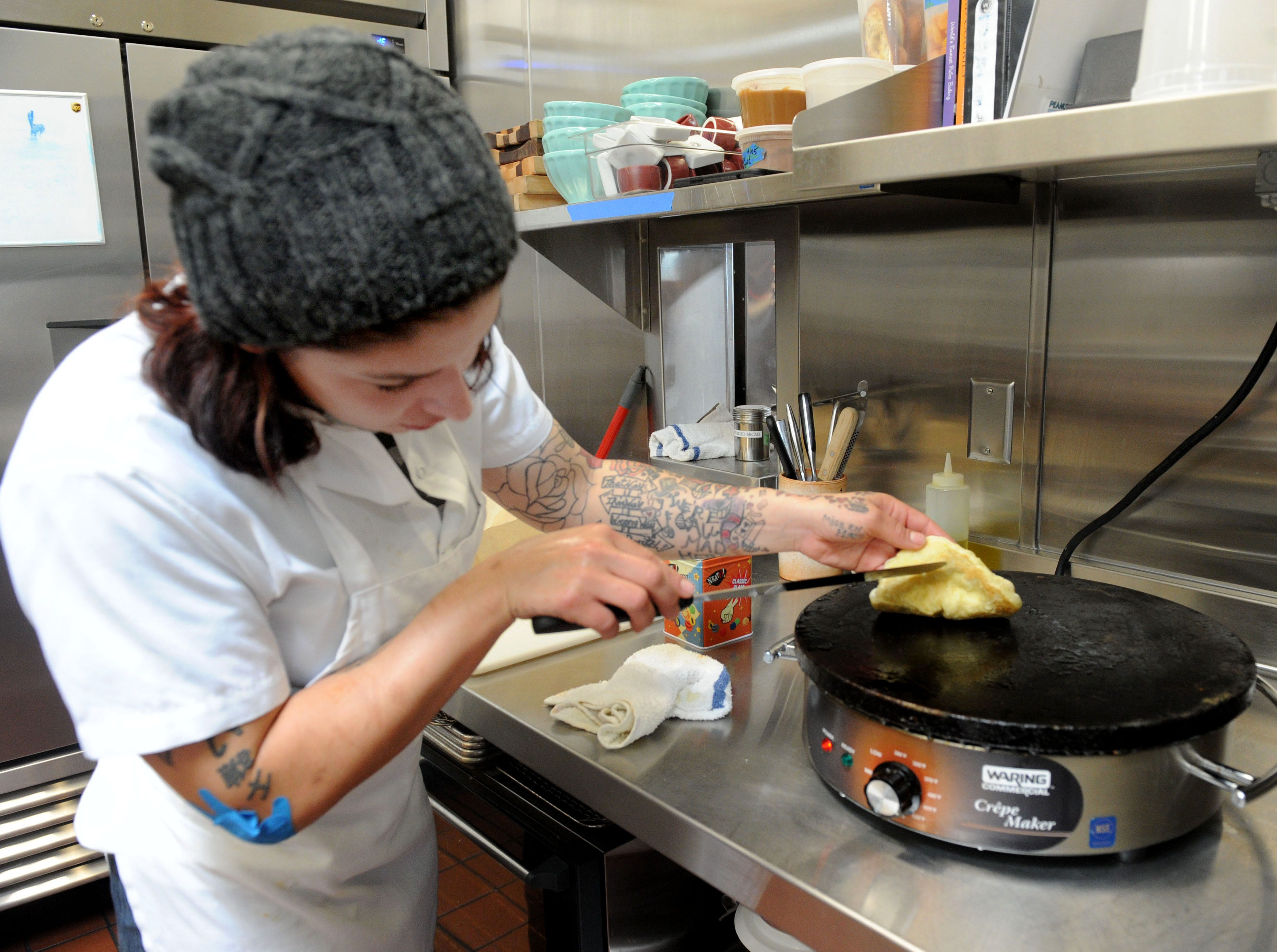 Frankie Lopez, commis chef at Sage Mindful Meals and Elixirs in Ojai, makes naan bread.