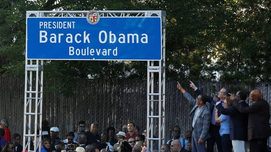 At podium, from left, Los Angeles City Council President Herb Wesson, Mayor Eric Garcetti, state Sen. Maria Elena Durazo, Los Angeles County Supervisor Mark Ridley-Thomas and Los Angeles Urban League President and CEO Matthew Lawson unveil the Obama Boulevard sign in Los Angeles on Saturday.