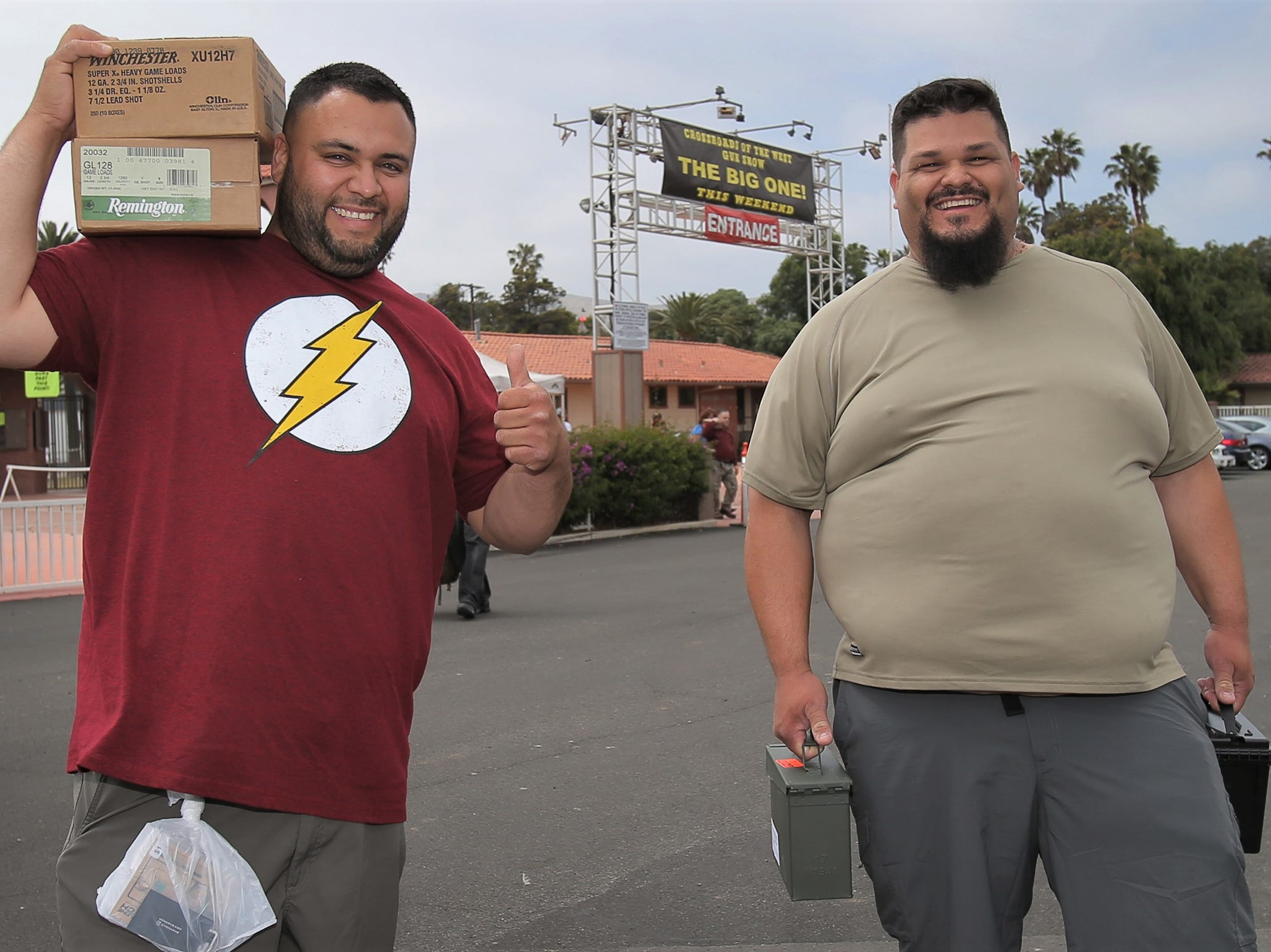 Ricardo Duran, left, and Ignacio Blanco, both of Los Angeles, leave the Crossroads of the West Gun Show that was held Saturday at the Ventura County Fairgrounds. Both hope the show doesn't go away but if it does, they will travel to other cities if they have to.