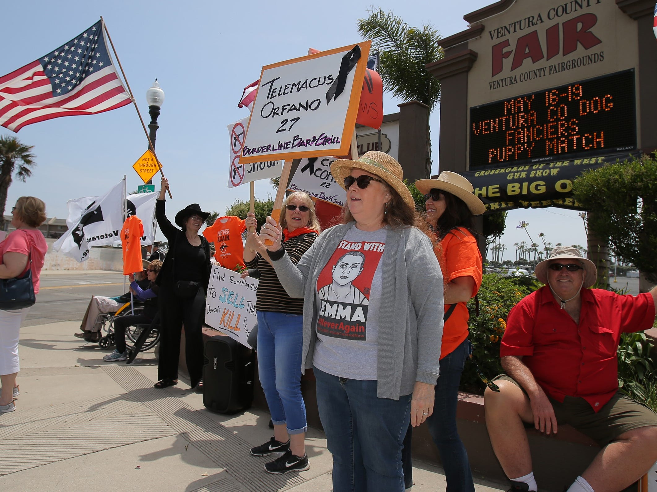 Troy Corley, in gray sweater, and her fellow gun-control advocates protest at the Crossroads of the West Gun Show on Saturday at the Ventura County Fairgrounds. They want the fairgrounds to stop hosting the gun show.