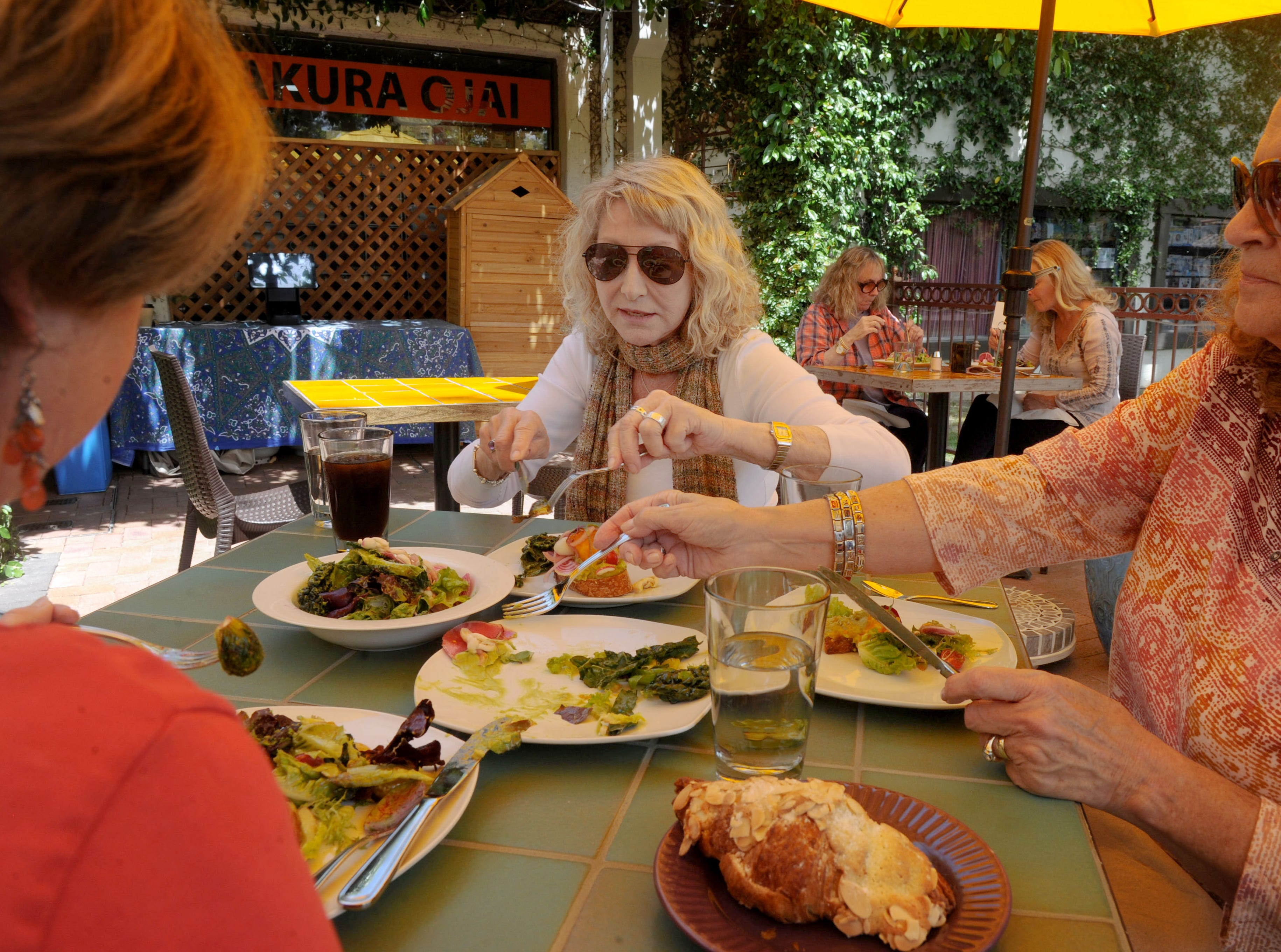 Sharon Markley, from left, Jacqueline Dorfman and Barbara Crowder enjoy sharing a couple of plates at Sage Mindful Meals and Elixirs in Ojai.