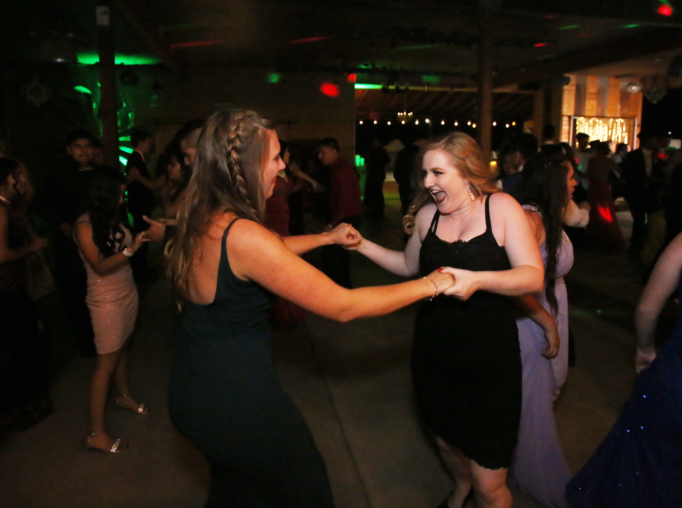 Morgan Weldon and Morgan Dougherty have fun at the Exeter Union High School prom Saturday, May 4, 2019 in Woodlake, Calif.