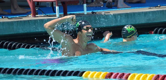 El Diamante's Preston Niayesh celebrates after winning the 100-yard breaststroke on Saturday at the Central Section swimming championships at Clovis West High School.