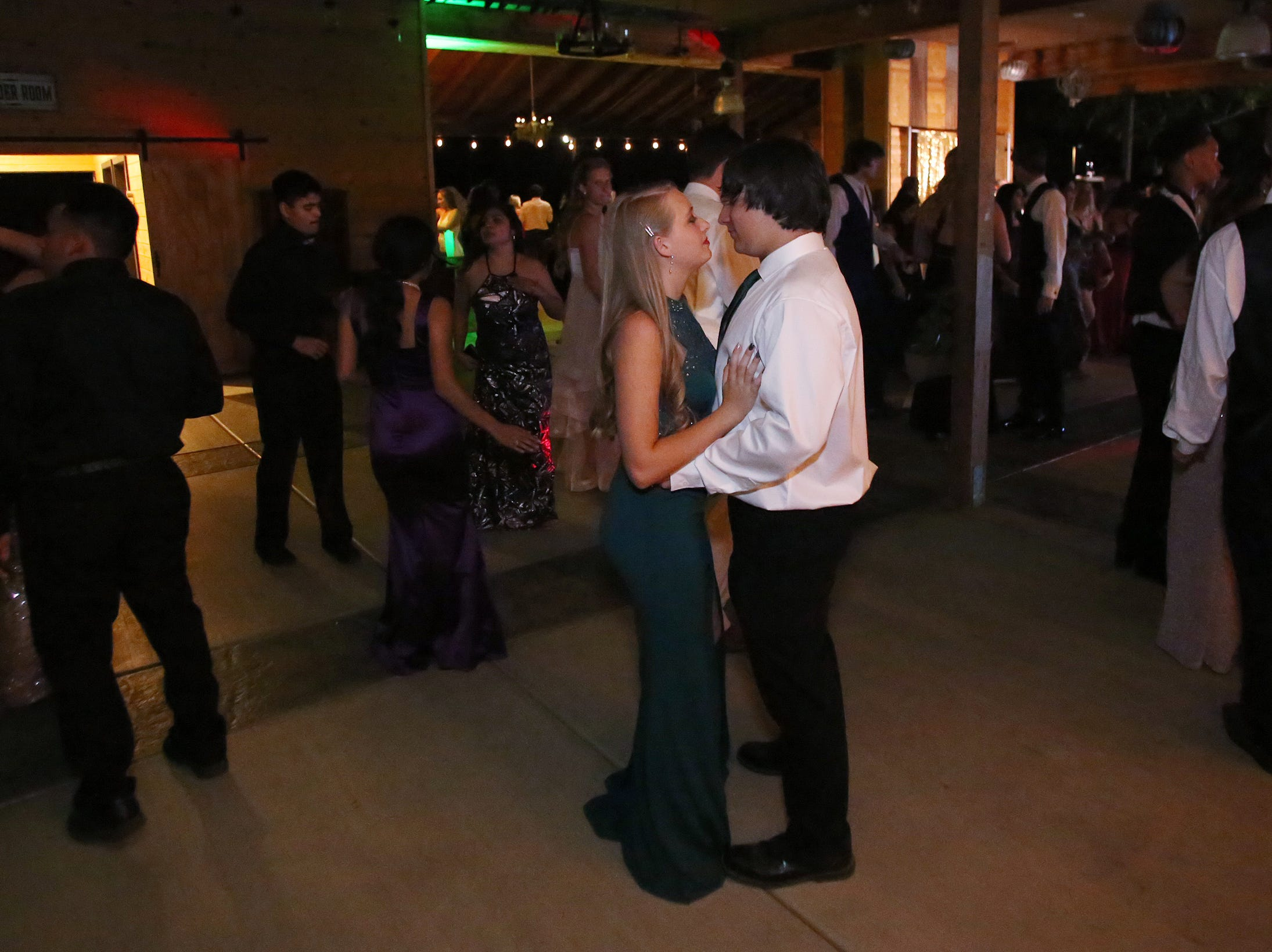 Tyler Fredrickson and Cassie Whitney enjoy a slow dance at the Exeter Union High School prom Saturday, May 4, 2019 in Woodlake, Calif.