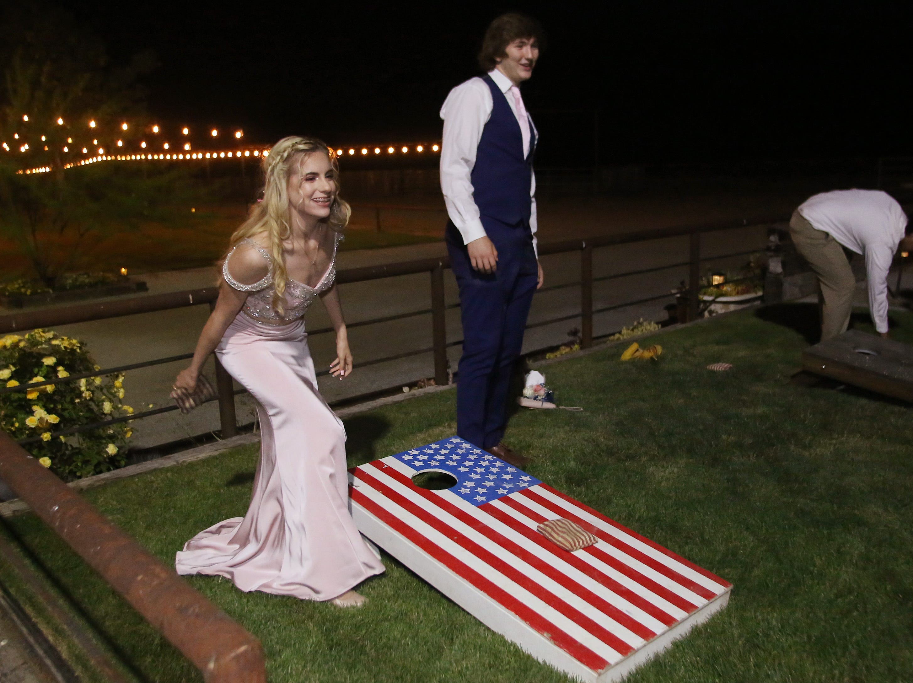 Amber Zeno and Eric Mittlestad have fun at the bean bag tosss at the Exeter Union High School prom Saturday, May 4, 2019 in Woodlake, Calif.