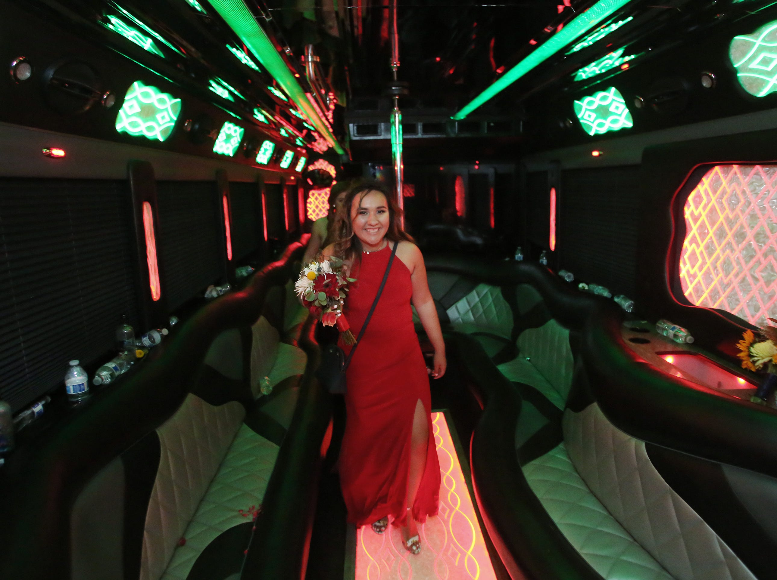 Lexe Cortez leaves the party bus before joining friends at the Exeter Union High School prom Saturday, May 4, 2019 in Woodlake, Calif.