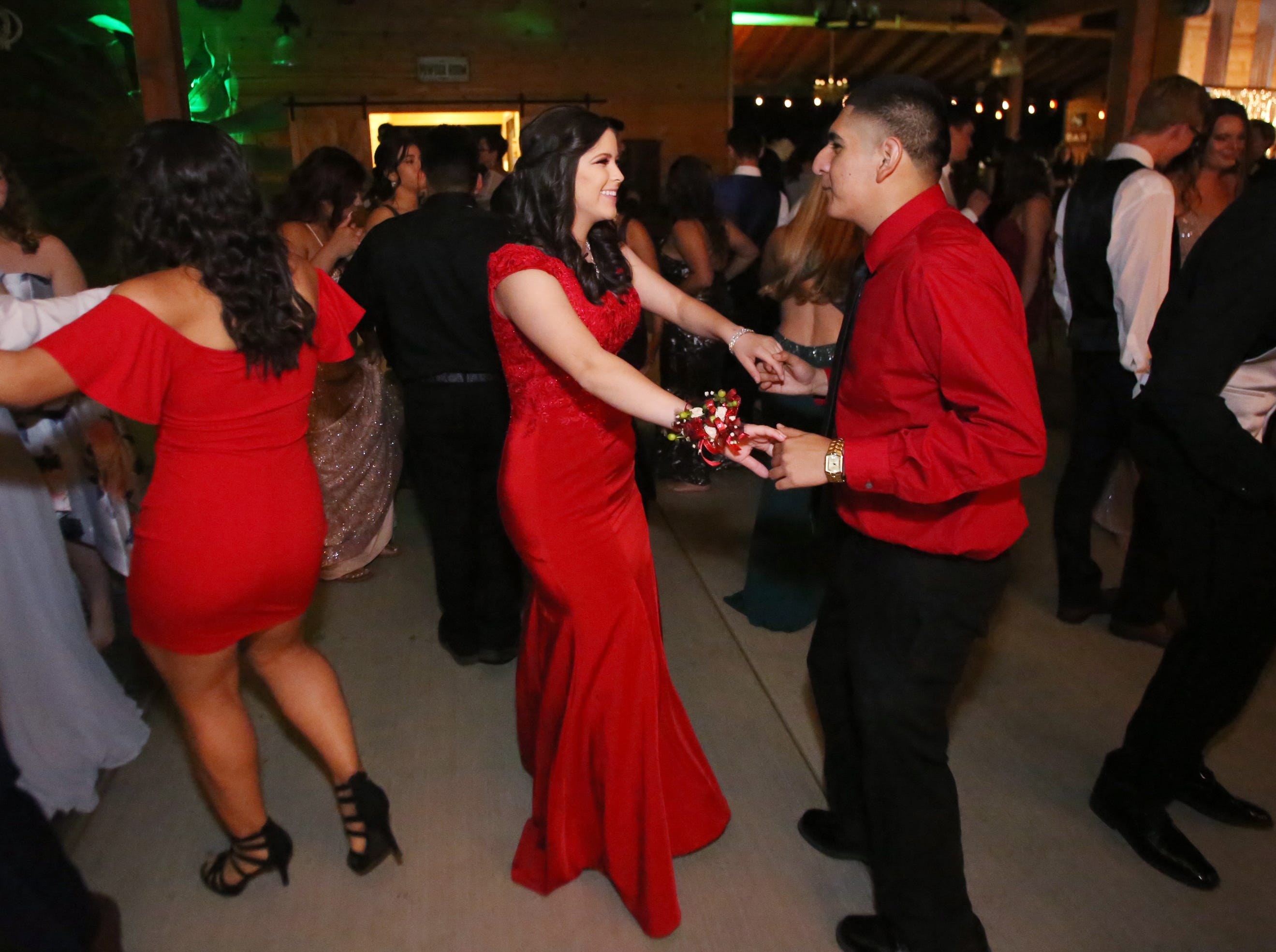 Faustino Ramos and Esmeralda Quiroz enjoy a fast dance at the Exeter Union High School prom Saturday, May 4, 2019 in Woodlake, Calif.