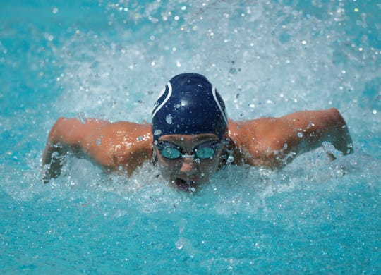 Redwood's Alex Roberts competes in the girls 100-yard butterfly on Saturday at the Central Section swimming championships at Clovis West High School.