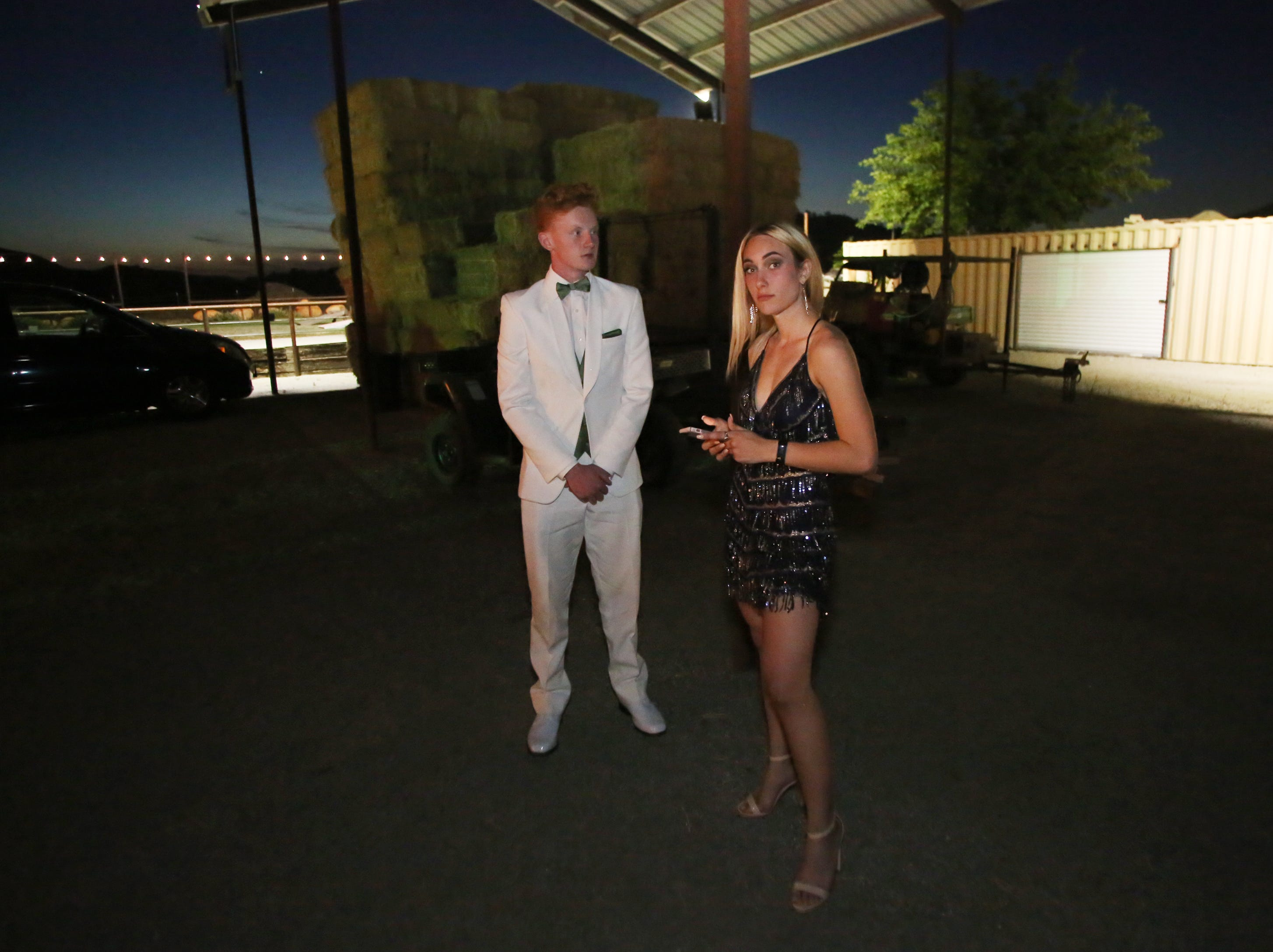Bradley Fakes and Bradi Starnes wait for friends to arrive shown at the Exeter Union High School prom Saturday, May 4, 2019 in Woodlake, Calif.