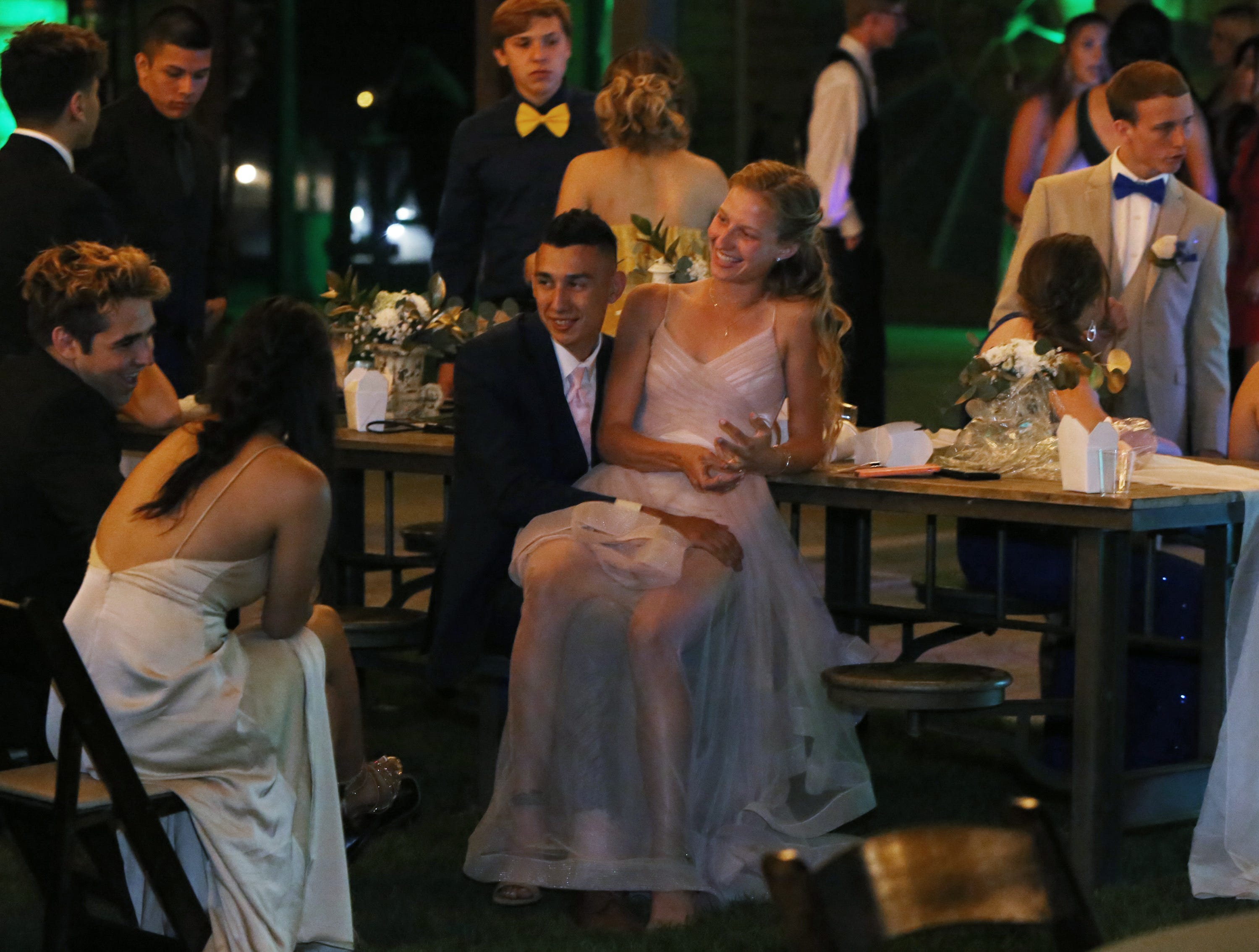 Jaykob Acosta and Julia Nelson chat with friends at the Exeter Union High School prom Saturday, May 4, 2019 in Woodlake, Calif.
