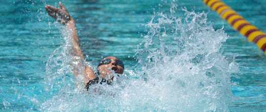 Redwood's Alex Roberts competes in the girls 100-yard backstroke on Saturday at the Central Section swimming championships at Clovis West High School.