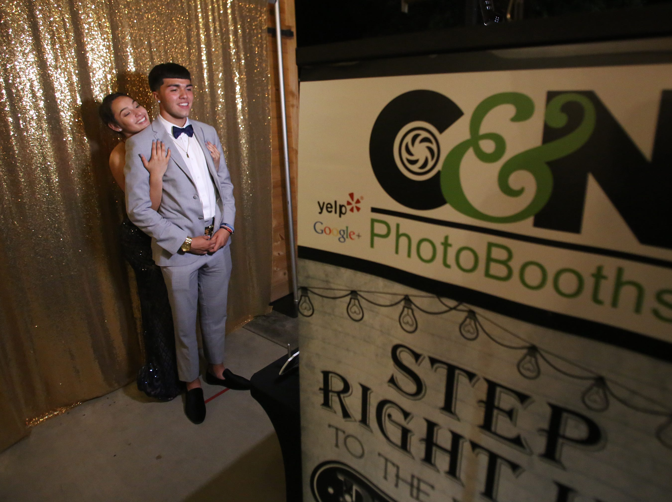 Josiah Martinez and Jill Nelson have fun at the photo booth during this year's Exeter Union High School prom Saturday, May 4, 2019 in Woodlake, Calif.