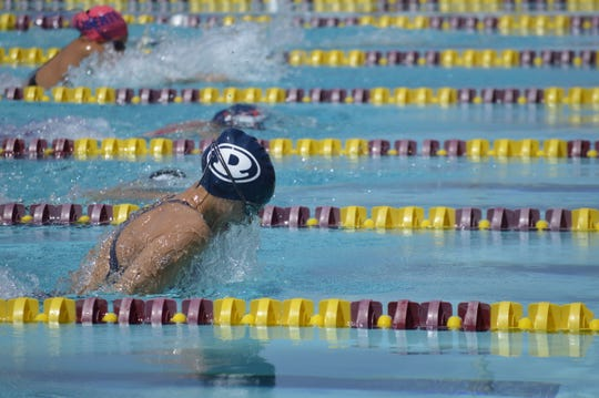 Redwood's Megan Ridenour swims in the girls 100-yard breaststroke on Saturday at the Central Section swimming championships at Clovis West High School.