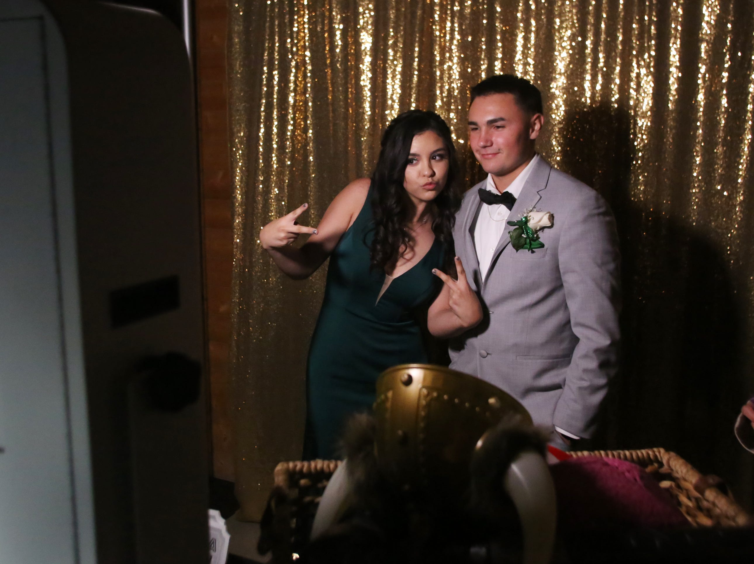 Cheyenne Lynch and Josh Perez share a moment in the C&N photo booth at the Exeter Union High School prom Saturday, May 4, 2019 in Woodlake, Calif.