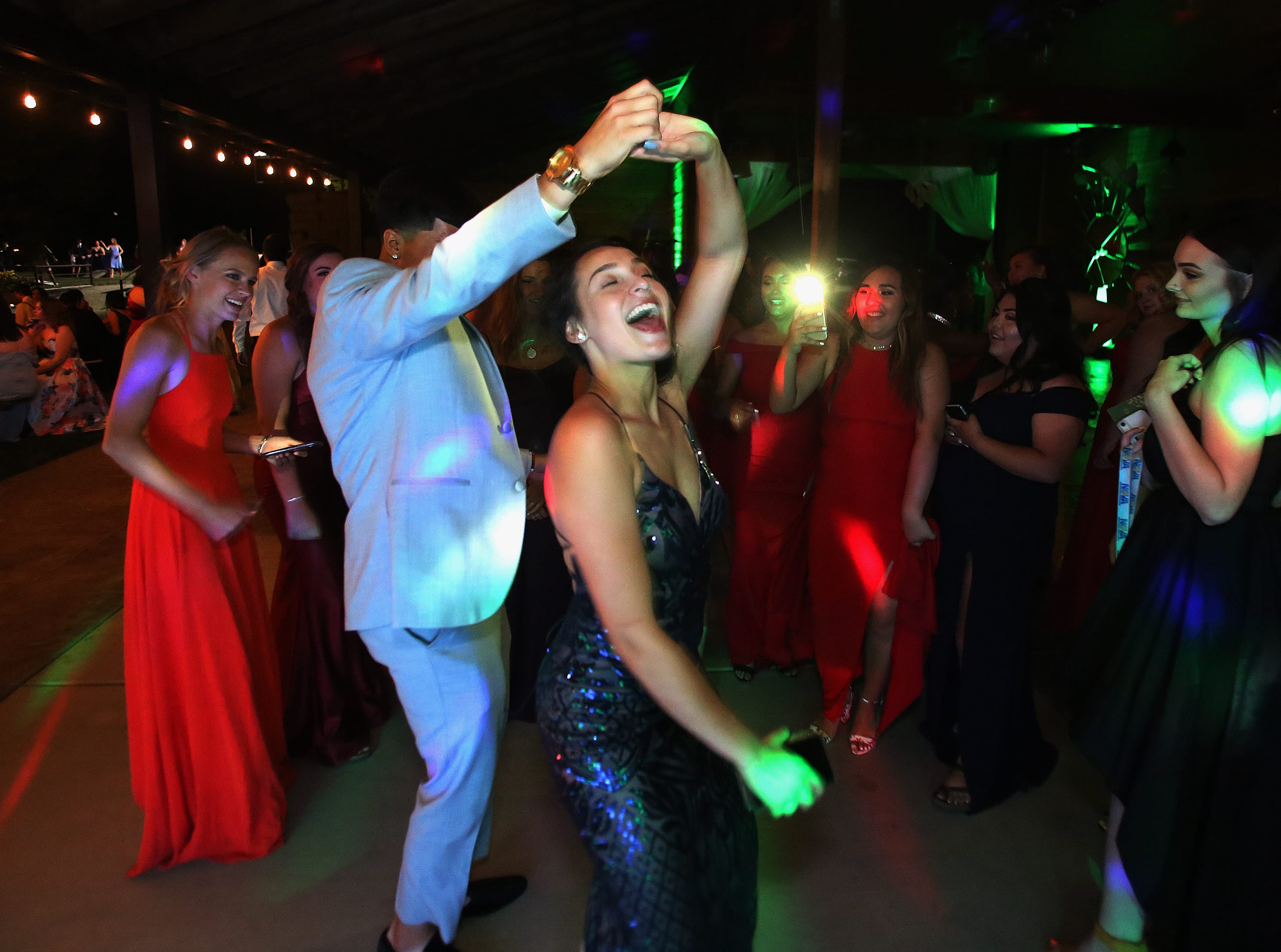 Jill Nelson and Josiah Martinez have fun dancing at this year's Exeter Union High School prom Saturday, May 4, 2019 in Woodlake, Calif.