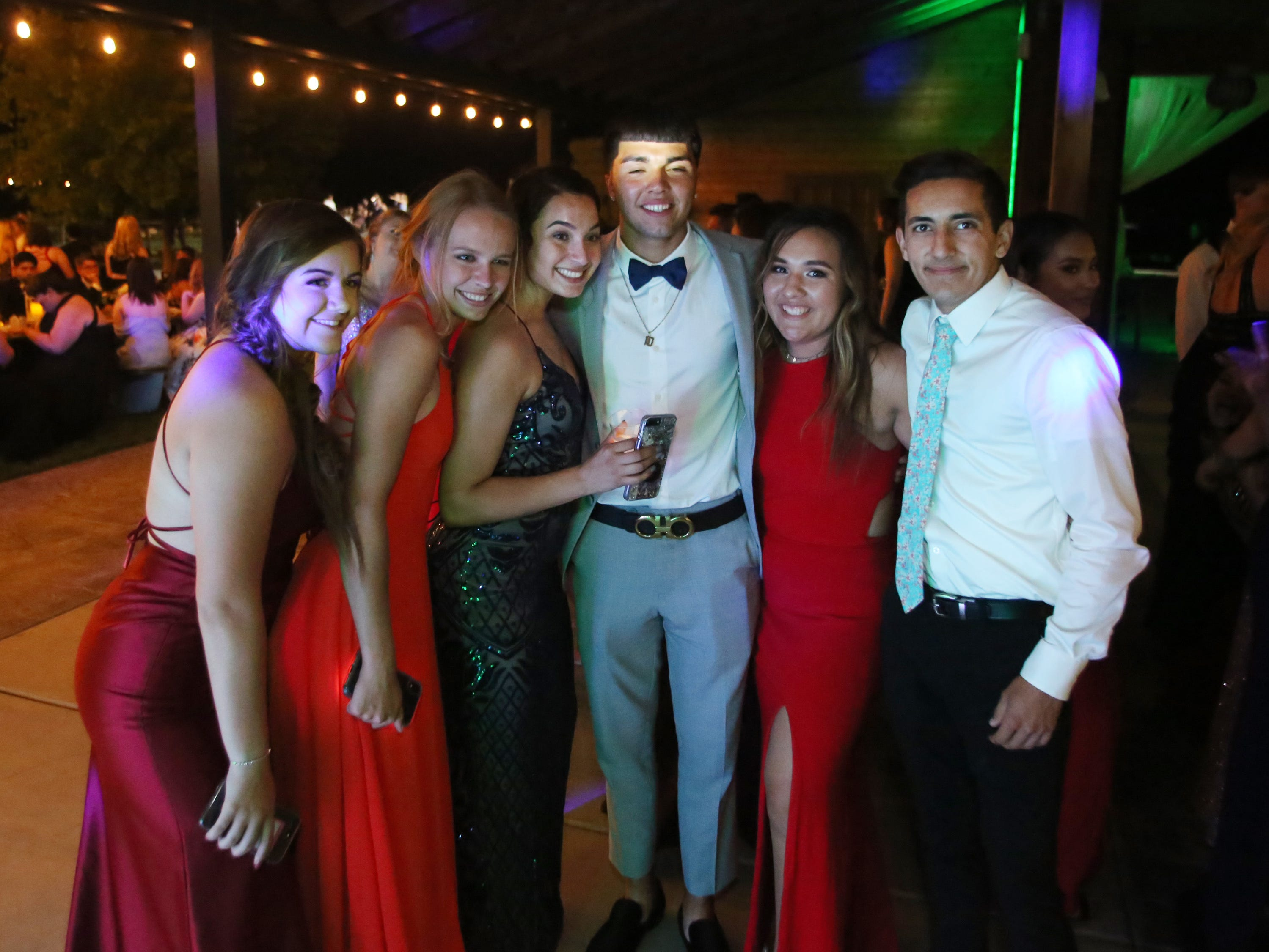 From left to right, Alexis Gregory, Mattie Fry, Jill Nelson, Jsiah Martinez and Lexe Cortez are shown at the Exeter Union High School prom Saturday, May 4, 2019 in Woodlake, Calif.