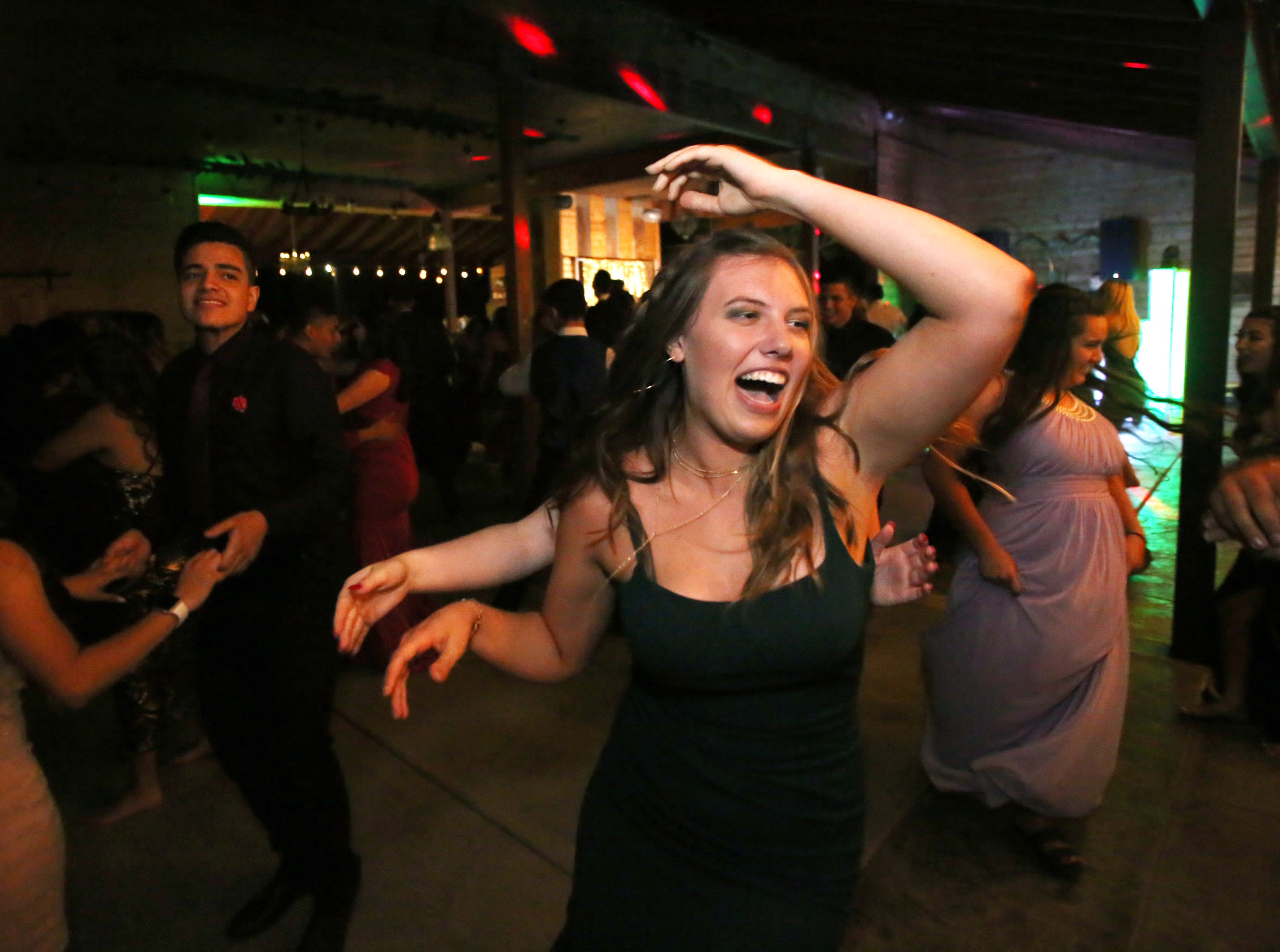 Morgan Weldon has fun at the Exeter Union High School prom Saturday, May 4, 2019 in Woodlake, Calif.