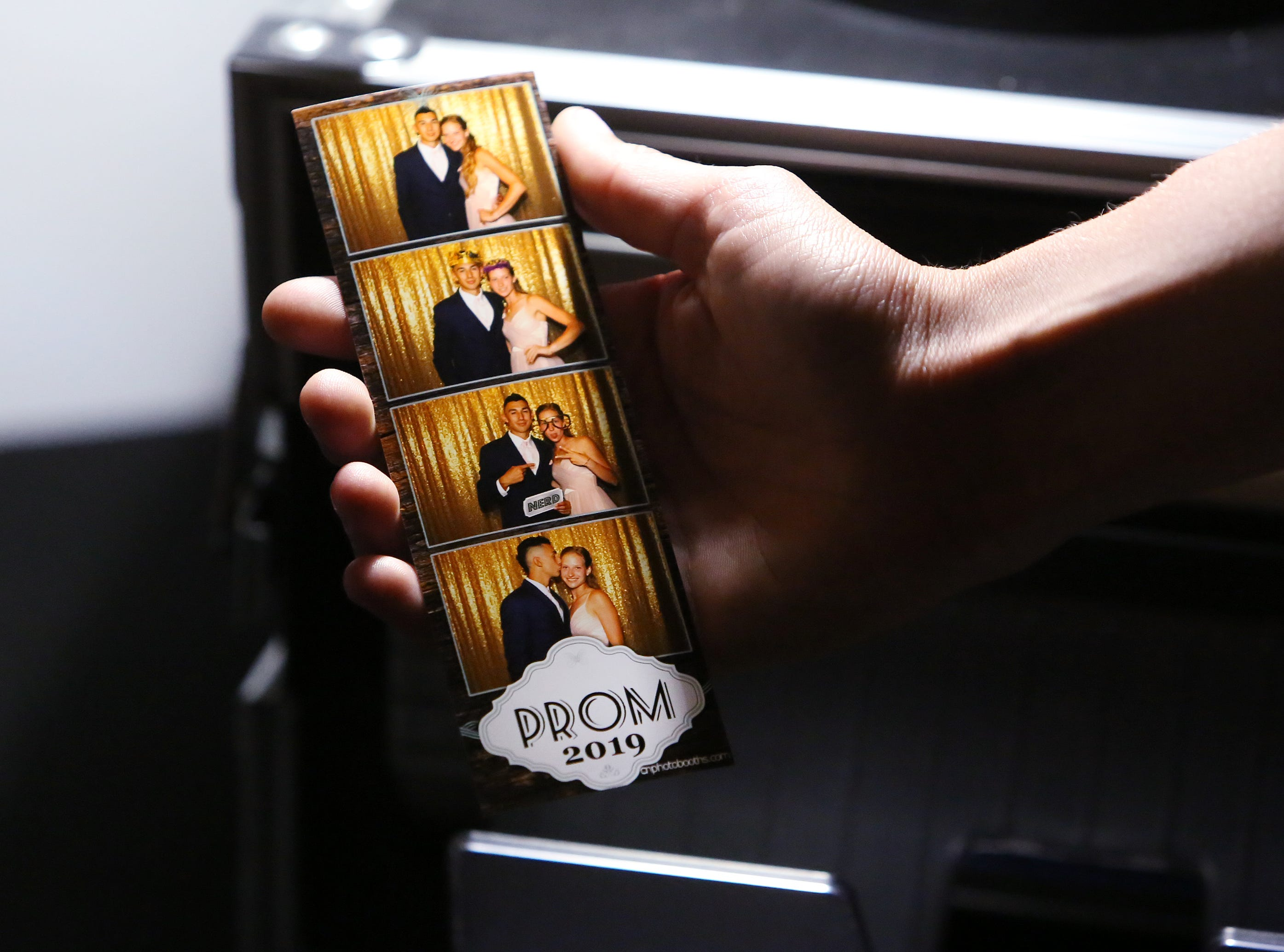 Julia Nelson and Jaykob Acosta share a fun moment at the photo booth at this year's Exeter Union High School prom Saturday, May 4, 2019 in Woodlake, Calif.